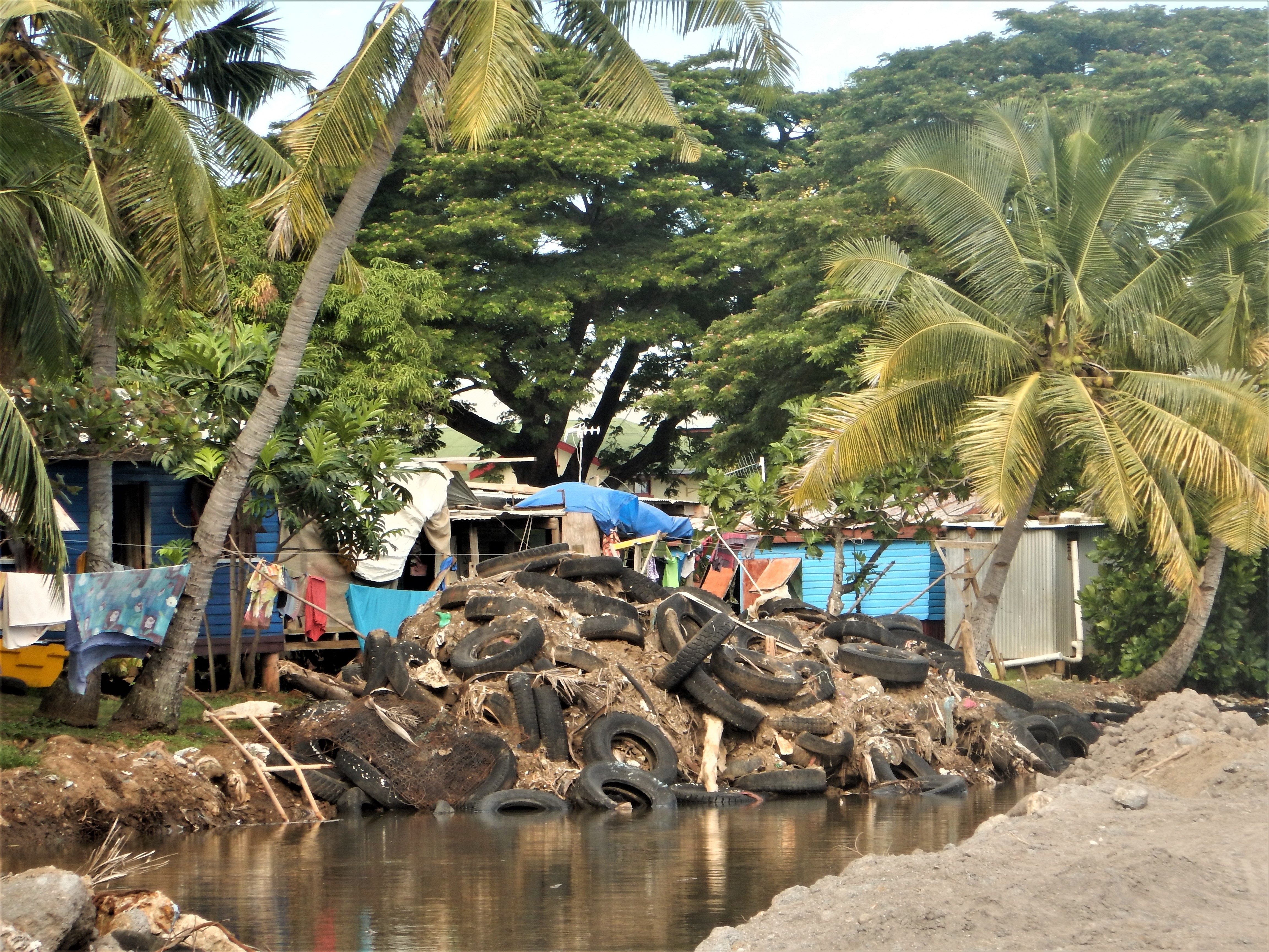 Stacking tires along the shore in Taiperia, Fiji helps prevent coastal erosion.