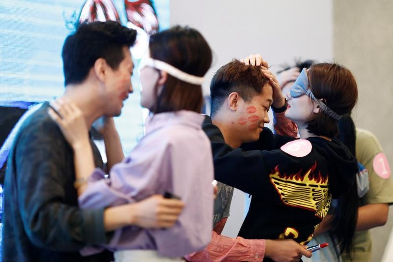 Couples take part in a kissing competition held inside a shopping mall in Taiyuan, Shanxi province, China May 20, 2018, to mark the date 520, which is phonetically similar to
