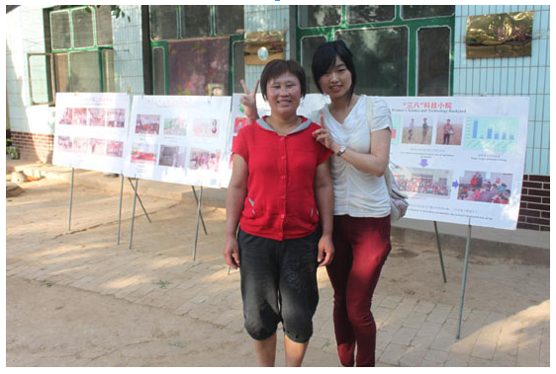 A student with the president of the female farmer field school in Fanli village