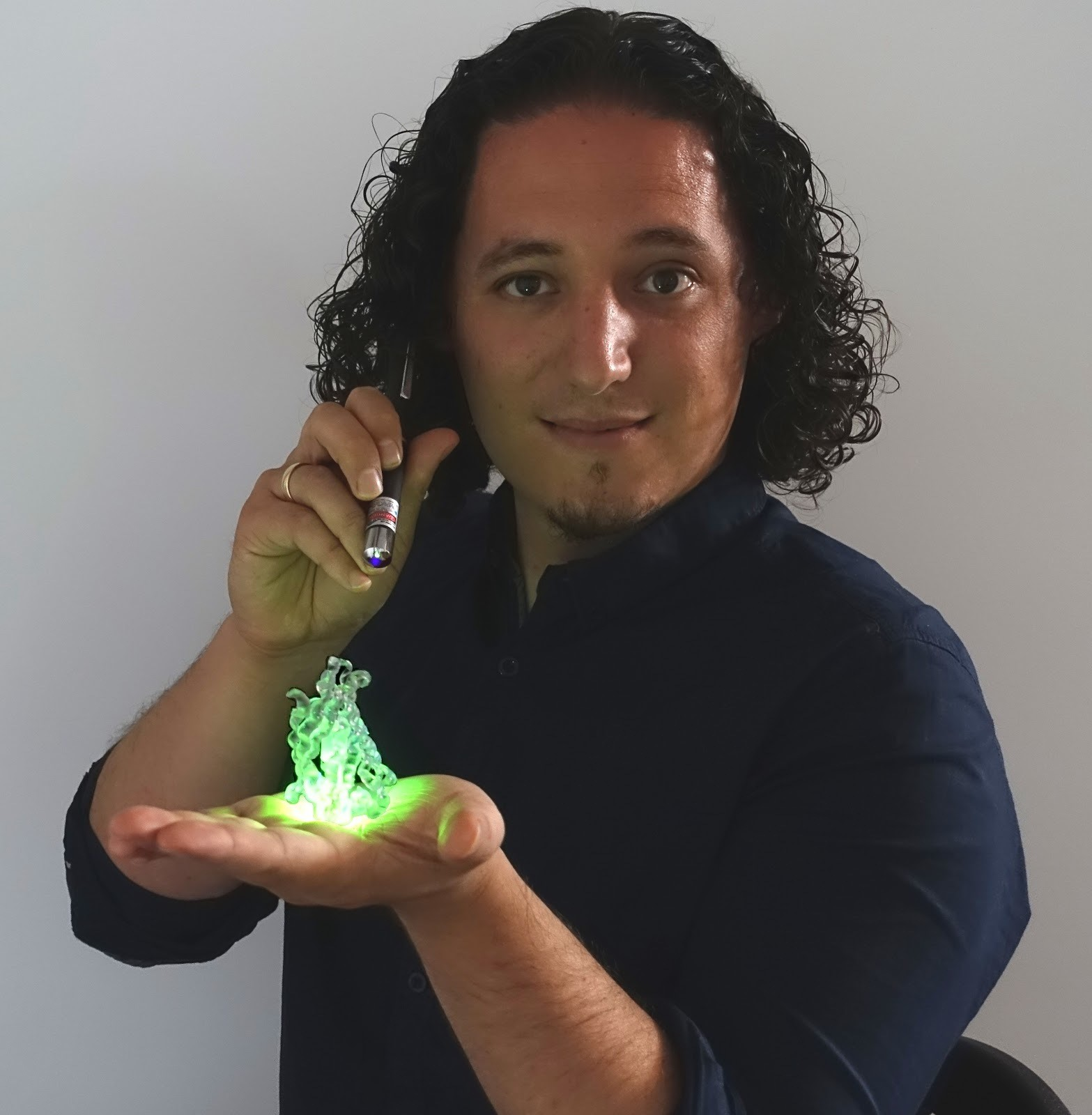 Dr Rubén Costa with his fluorescent polymer.