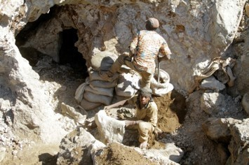 Congolese diggers work in an improvised mine near the town of Kambove.
