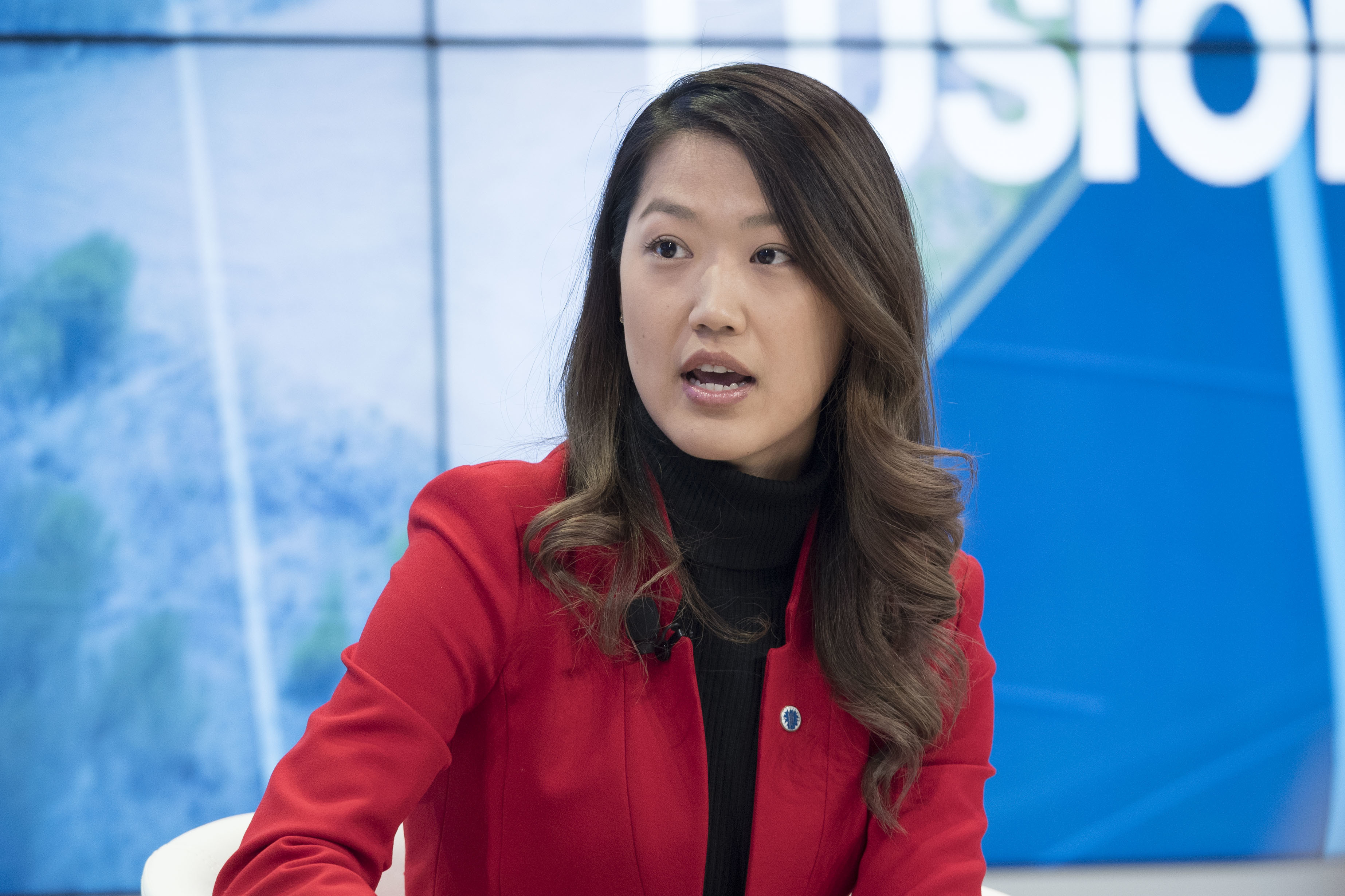 Kwiri Yang, Founder and Chief Executive Officer, Socha Connect, USA speaks during the Bridges vs Borders: The Migration Dilemma Session at the Annual Meeting 2018 of the World Economic Forum in Davos, January 26, 2018. Copyright by World Economic Forum / Valeriano Di Domenico