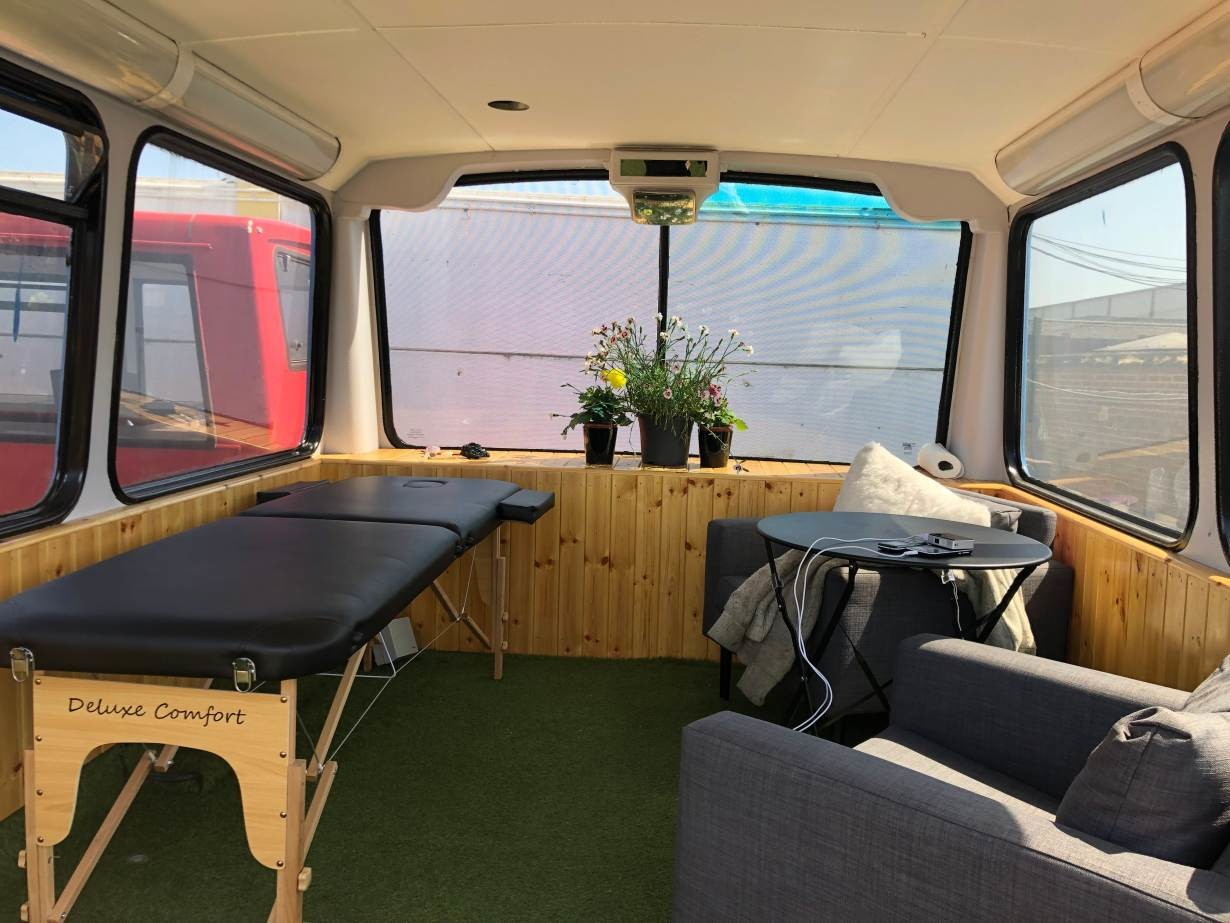 "A massage table and relaxing area on the ""wellbeing"" bus which will welcome homeless people in Croydon, south London, June 27, 2019."