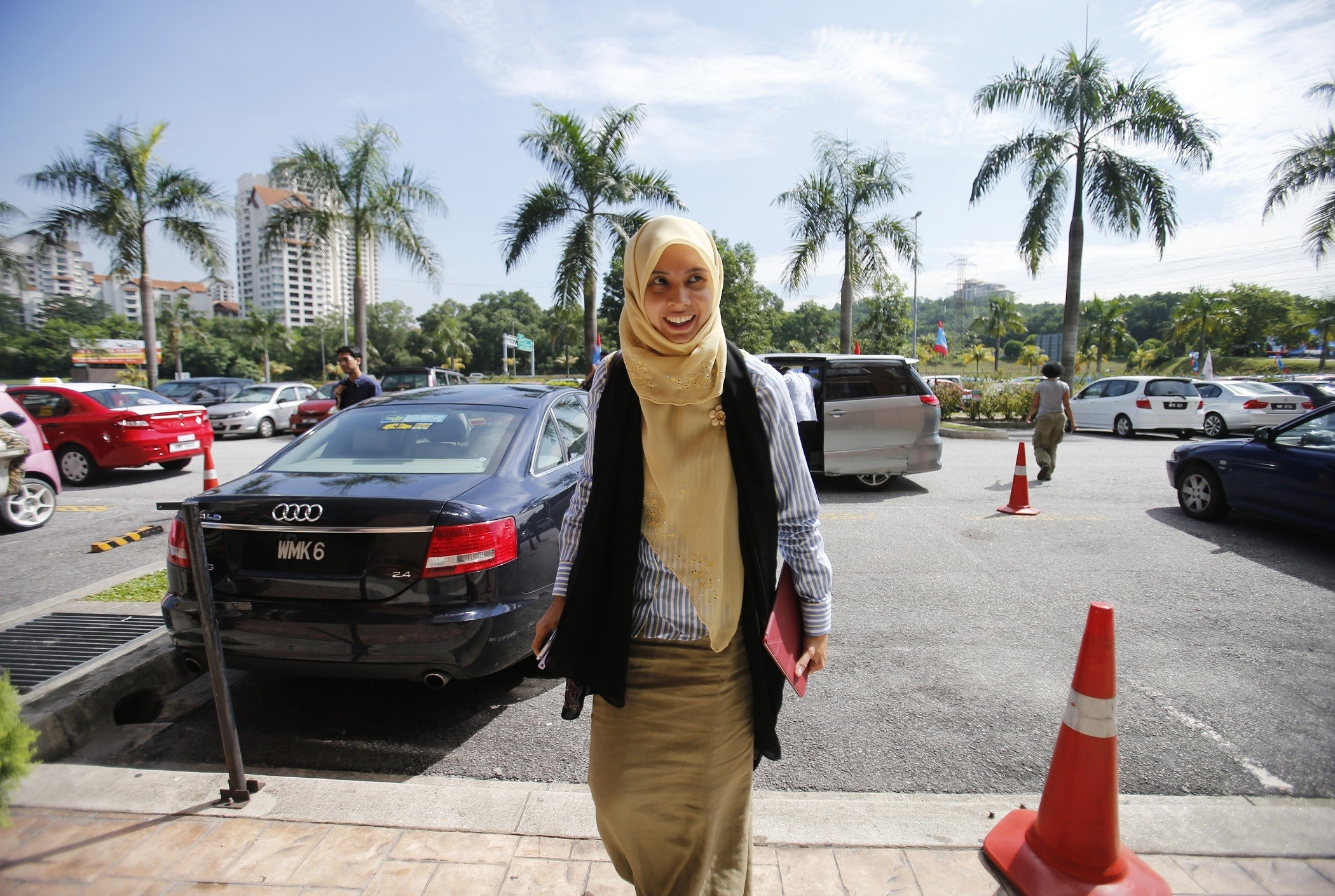 Nurul Izzah Anwar, a daughter of opposition leader Anwar Ibrahim, arrives at their party headquarters in Petaling Jaya outside Kuala Lumpur May 7, 2013. Anwar vowed on Tuesday to lead a