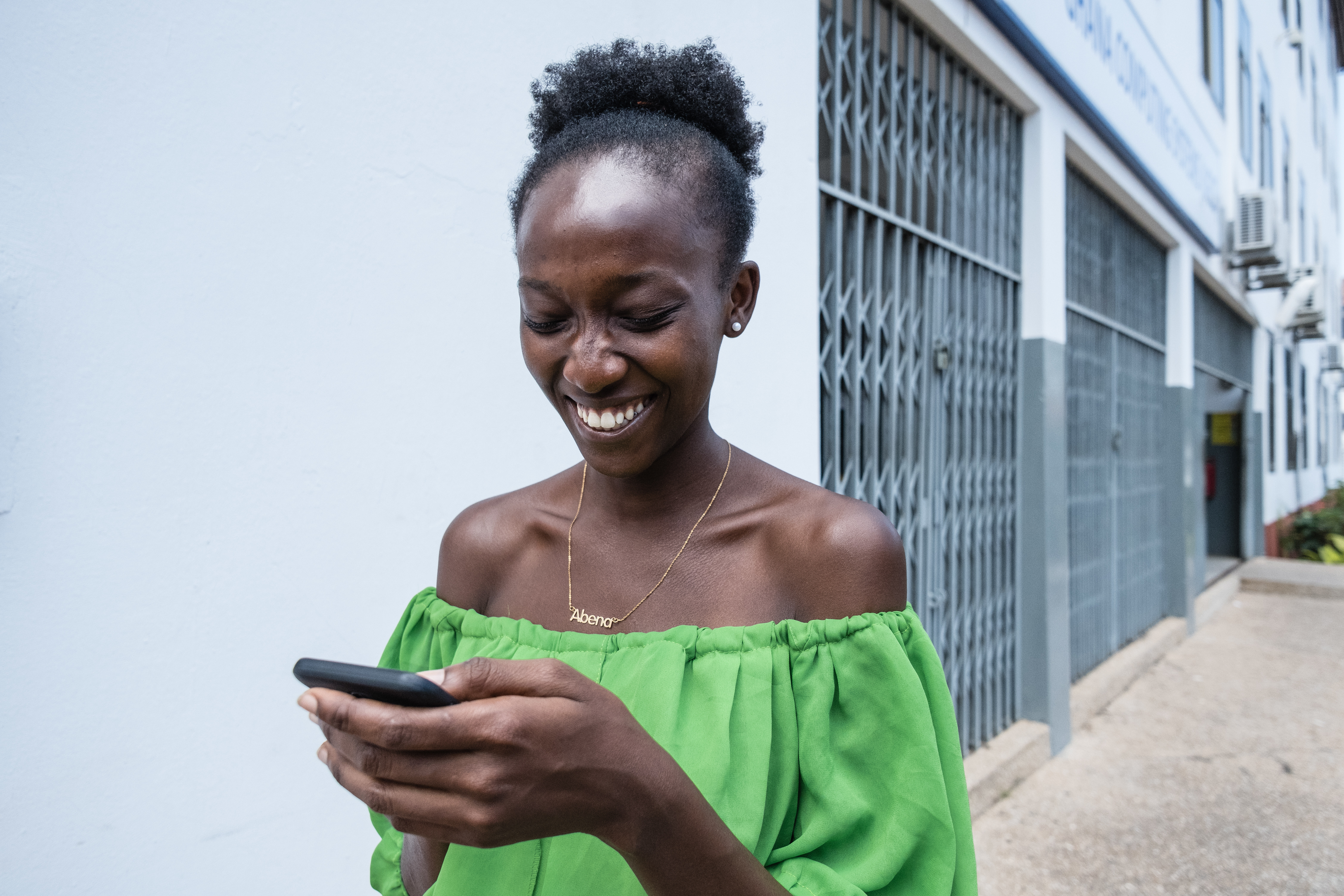 Cecilia Ansah a student of University of Ghana Accra where Csquared is providing fibre broad internet service on her mobile phone.