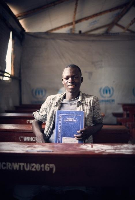 David with his exercise book, which he brought from South Sudan