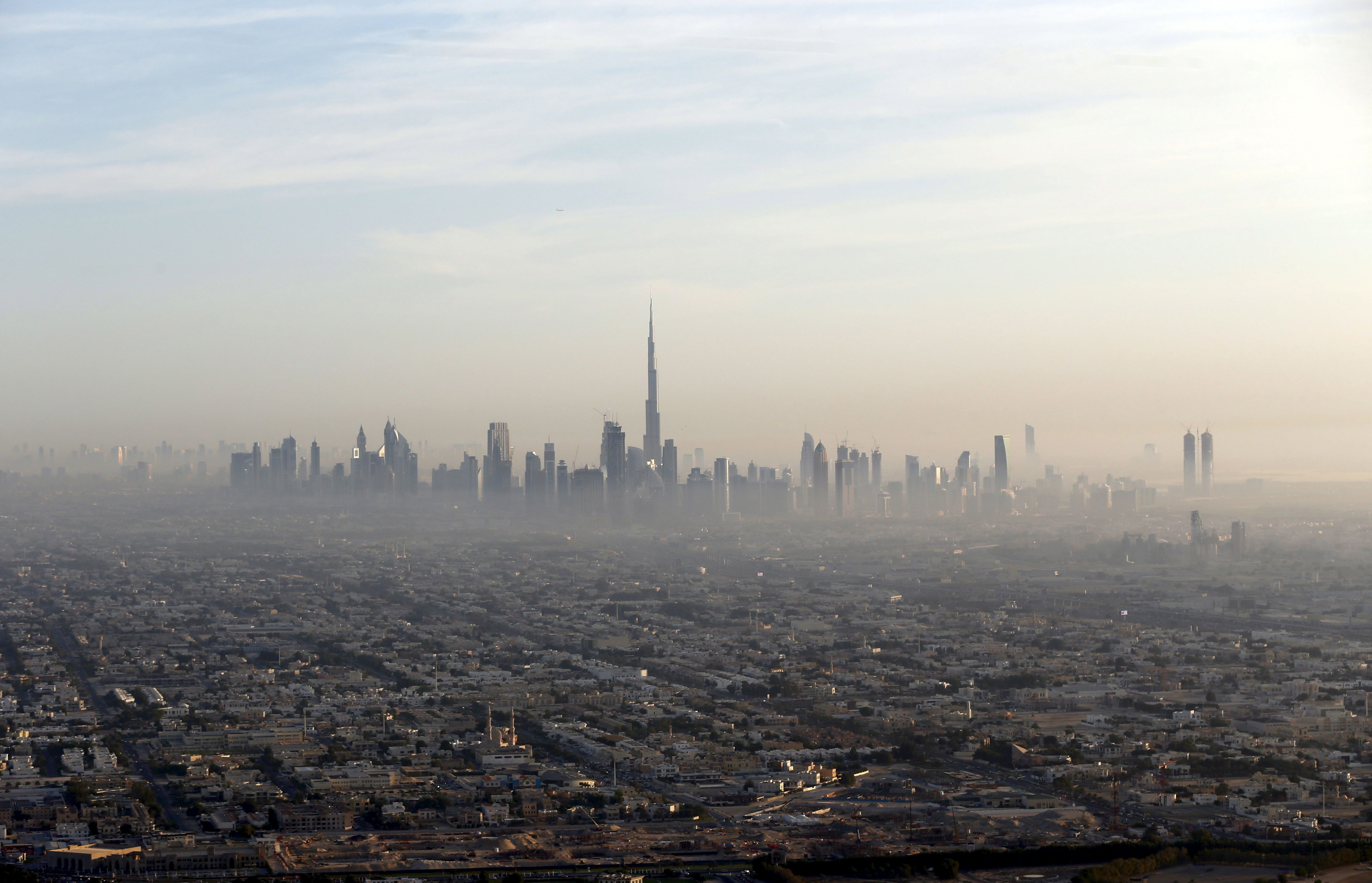 A general view of Dubai and the world's tallest tower, the <a href=