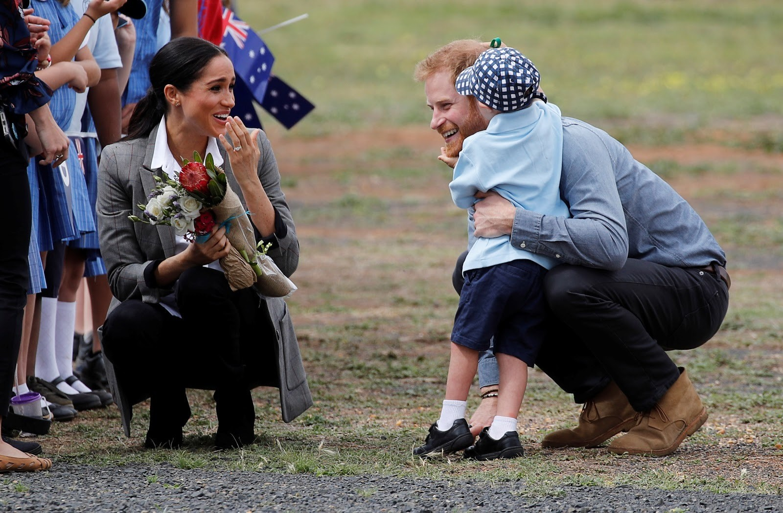 The Duke and Duchess of Sussex talk to five-year-old Luke Vincent in Australia