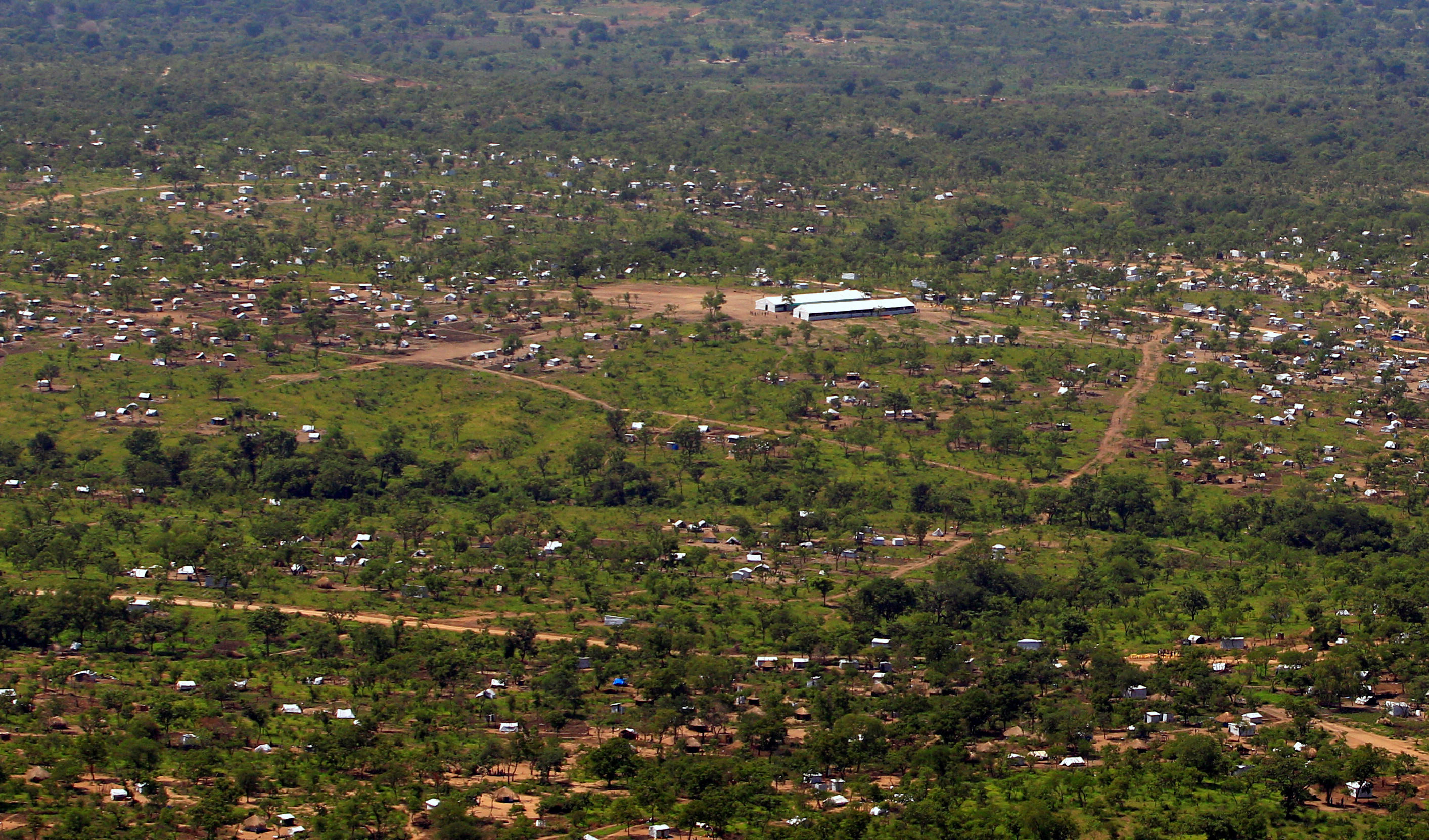 A view from a helicopter shows Imvepi settlement camp, where South Sudanese who fled civil war are being settled, in northern Uganda June 22, 2017. REUTERS/James Akena - RTS188CI