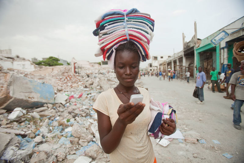 Ketteline Pierre, a high school student in Haiti, texts her friends.