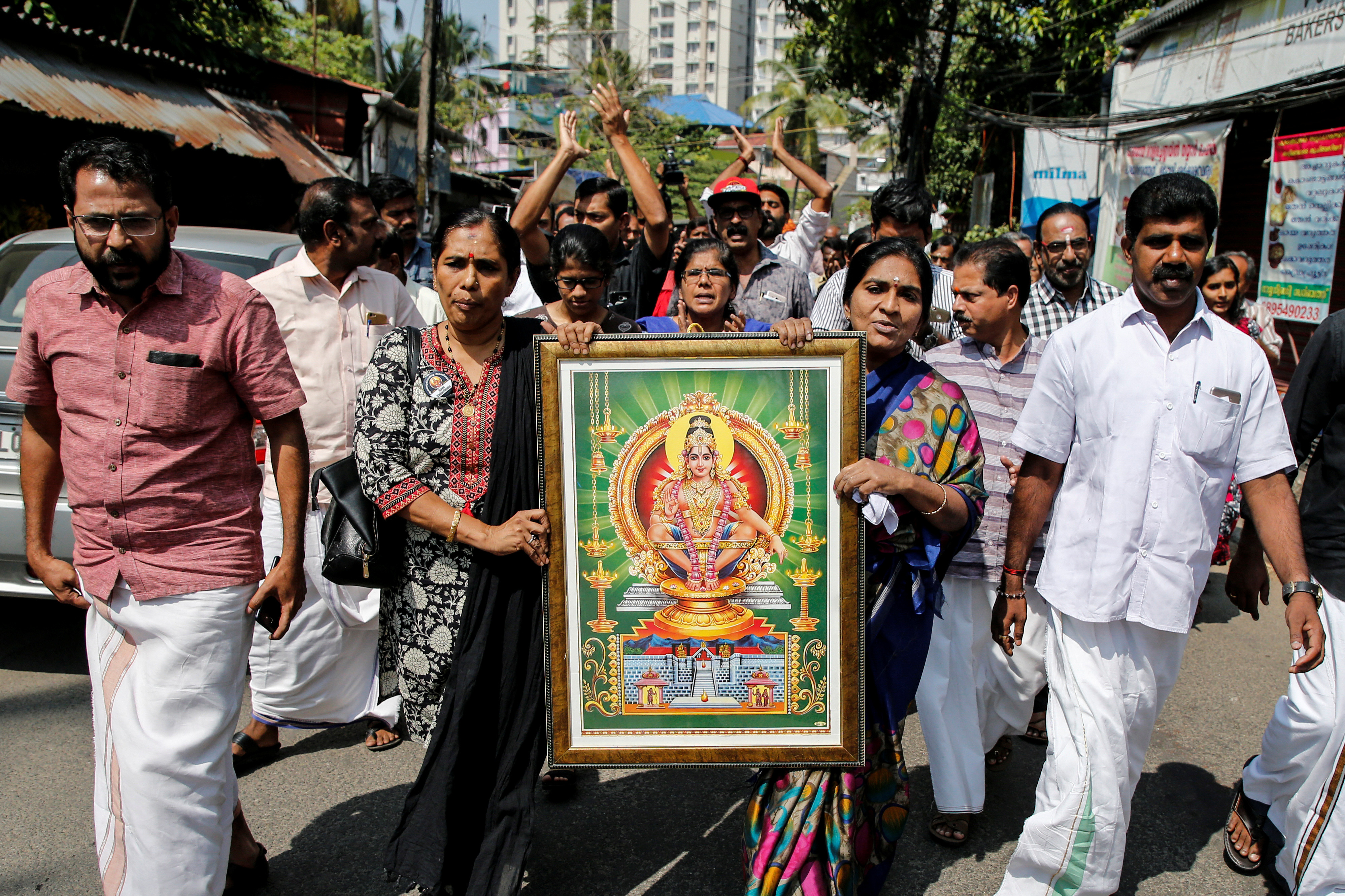"""Protesters hold a portrait of Hindu deity """"Ayappa"""" as they take part in a rally called by various Hindu organisations after two women entered the Sabarimala temple, in Kochi, India, January 2, 2019. REUTERS/Sivaram V - RC15D0A67BD0"""