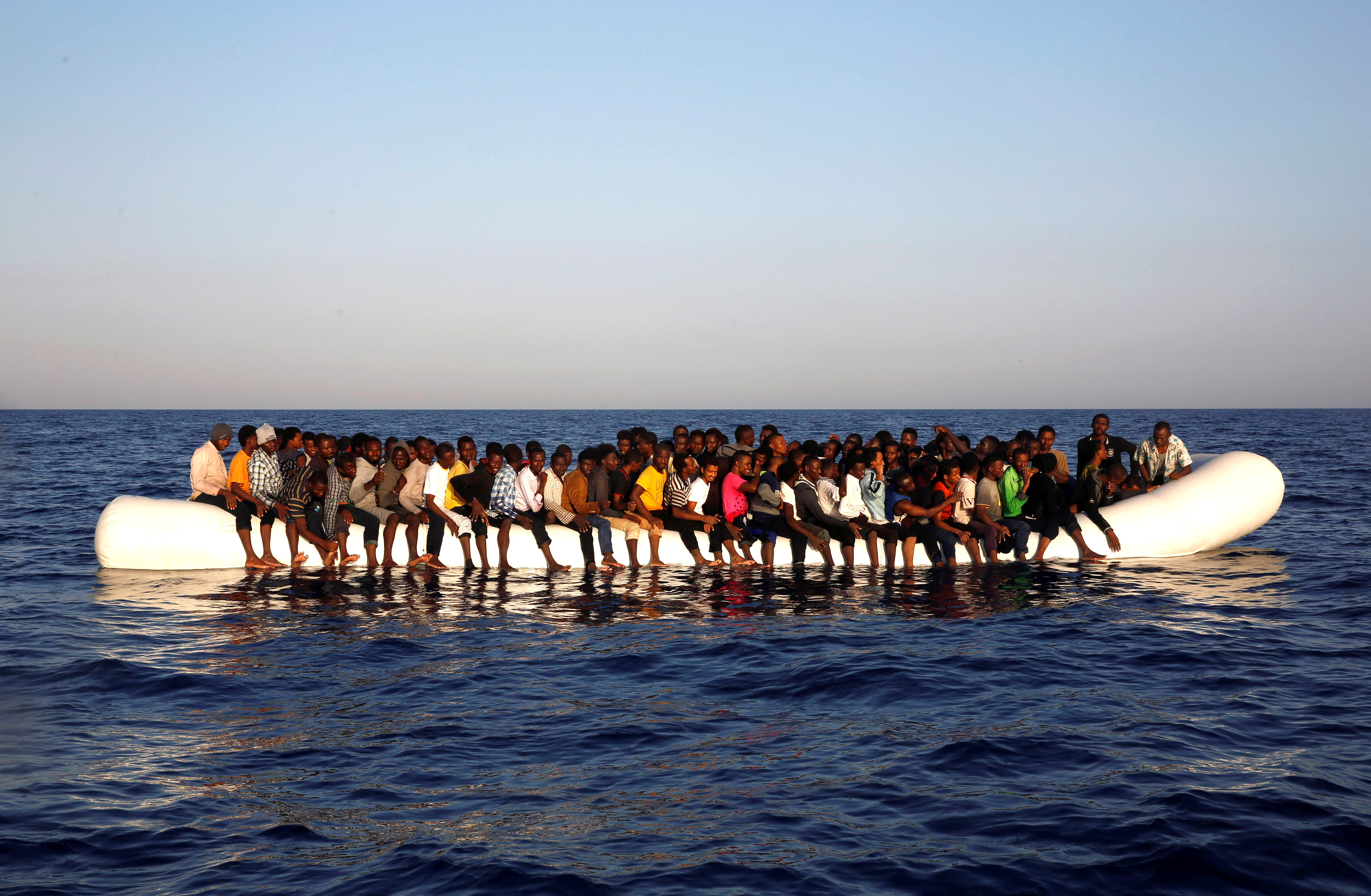 A dinghy overcrowded by African migrants is seen drifting off the Libyan coast in Mediterranean Sea August 20, 2016.  REUTERS/Giorgos Moutafis     TPX IMAGES OF THE DAY      - RTX2M8G7