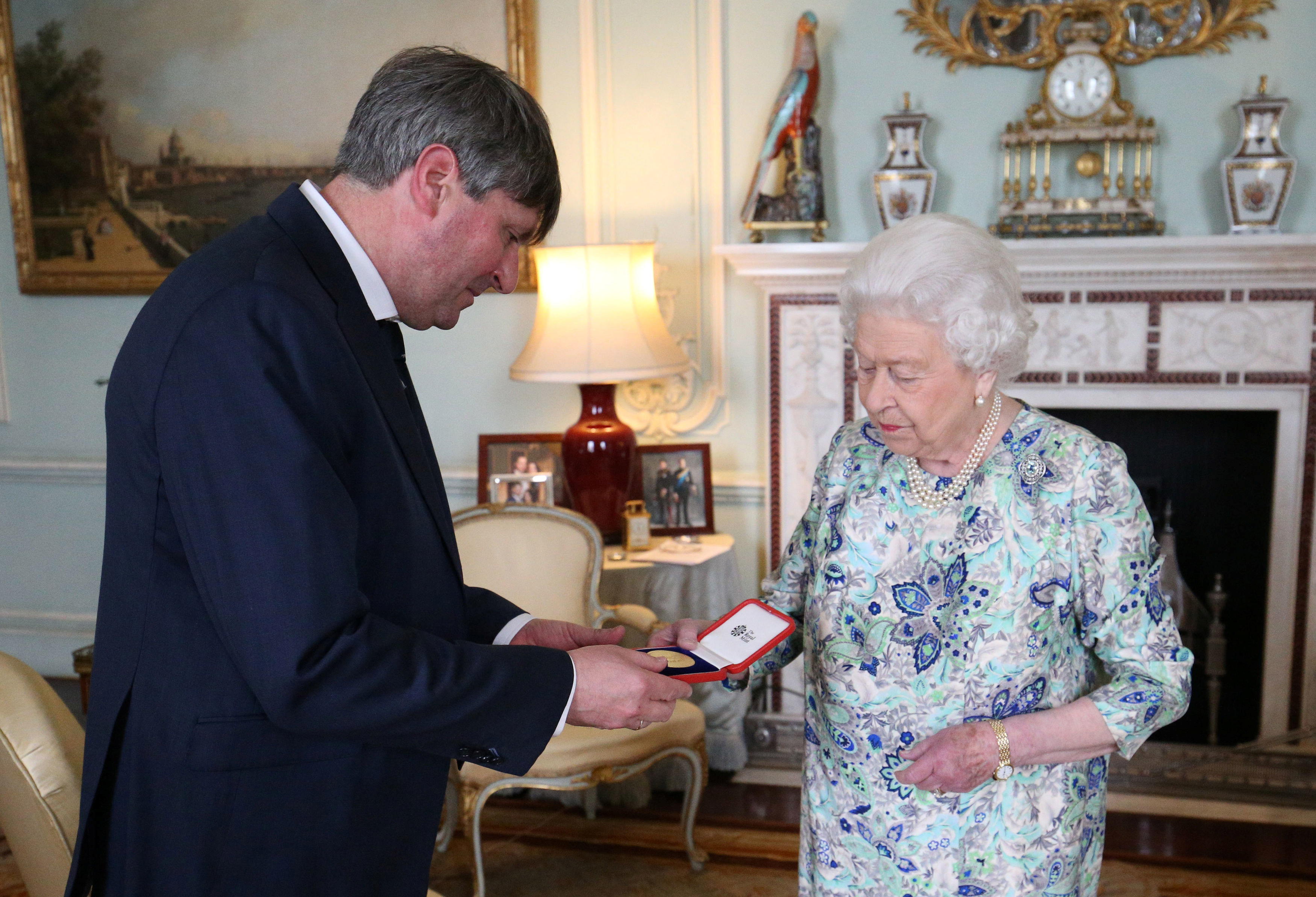 Queen Elizabeth presents Simon Armitage with The Queen's Gold Medal for Poetry upon his appointment as Poet Laureate during an audience at Buckingham Palace, London, Britain May 29, 2019.