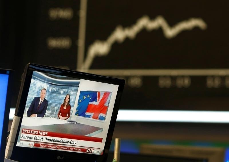 A news broadcast on a TV is pictured in front of the German share price index DAX board, at the stock exchange in Frankfurt, Germany, June 24, 2016, after Britain voted to leave the European Union in the EU BREXIT referendum. REUTERS/Ralph Orlowski