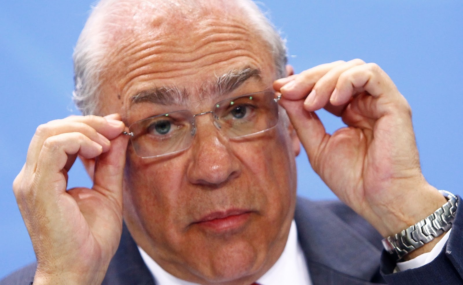 Jose Angel Gurria, Secretary-General of the Organisation for Economic Co-operation and Development (OECD) adjusts his glasses as he attends a news conference  with representatives of the trade organizations after a meeting in the chancellery in Berlin, Germany, June 11, 2018. REUTERS/Michele Tantussi - RC1AB57BE180