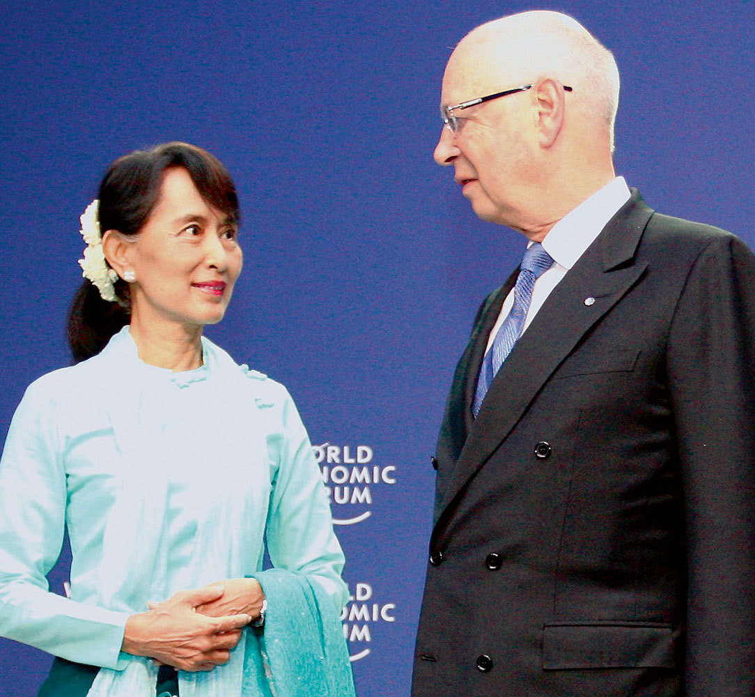 Klaus Schwab, Executive Chairman, World Economic Forum greet Aung San Suu Kyi, Chairwoman, National League for Democracy, Myanmar before a session