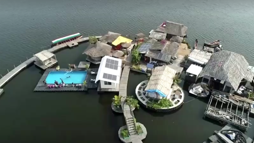 Holiday resort floating on the ocean on plastic bottle pollution.