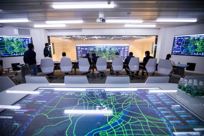 Screens showing traffic data of Hangzhou city are seen during a media tour of City Brain, an AI-powered traffic-management system by Alibaba Cloud, in Hangzhou, Zhejiang province, China April 10, 2018. Picture taken April 10, 2018. REUTERS/Stringer  ATTENTION EDITORS - THIS IMAGE WAS PROVIDED BY A THIRD PARTY. CHINA OUT. - RC14C6D462B0