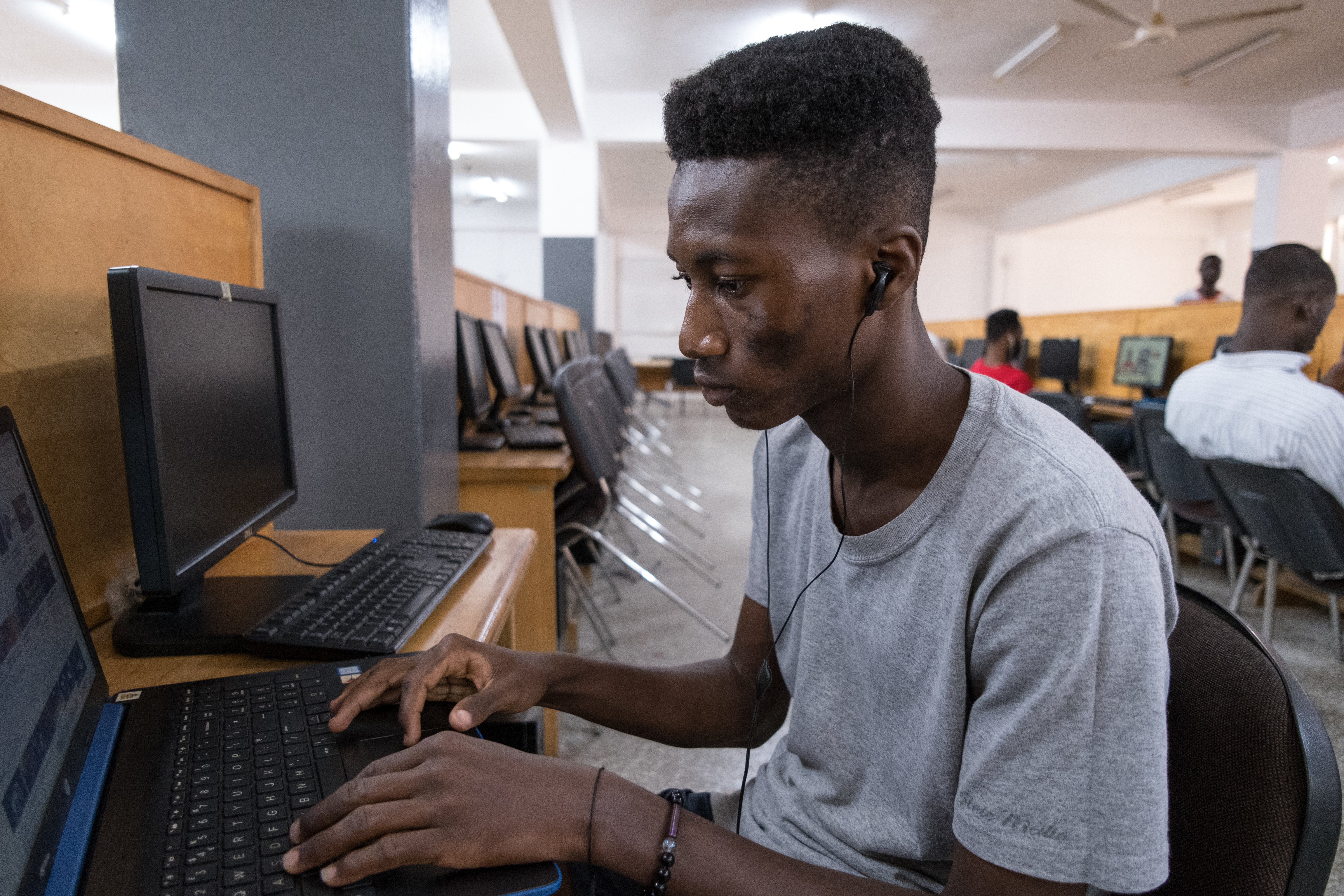 Owusu Michael19 years old, second year student at University of Ghana Accra computer lab where Csquared is providing fibre broad internet service