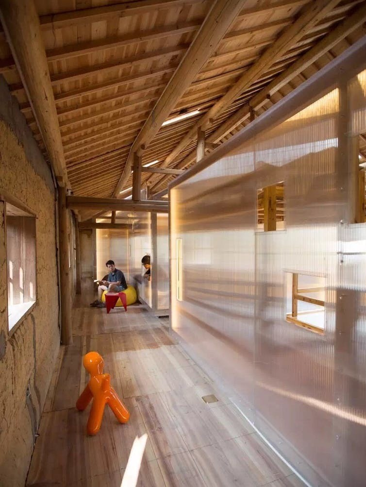Interior of the new-into-old building, with flexible timber structure to respond to the users' changing needs.