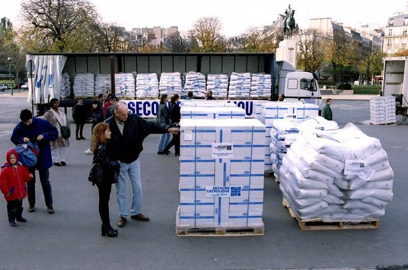 French humanitarian association 'Secours catholique' has unloaded part of 40 tons of foodstuffs at the Trocadero square November 9. Volunteers protest against international community which doesnt assist aid agencies in providing food and water to 1.2 million Hutu refugees trapped by fighting in eastern Zaire.