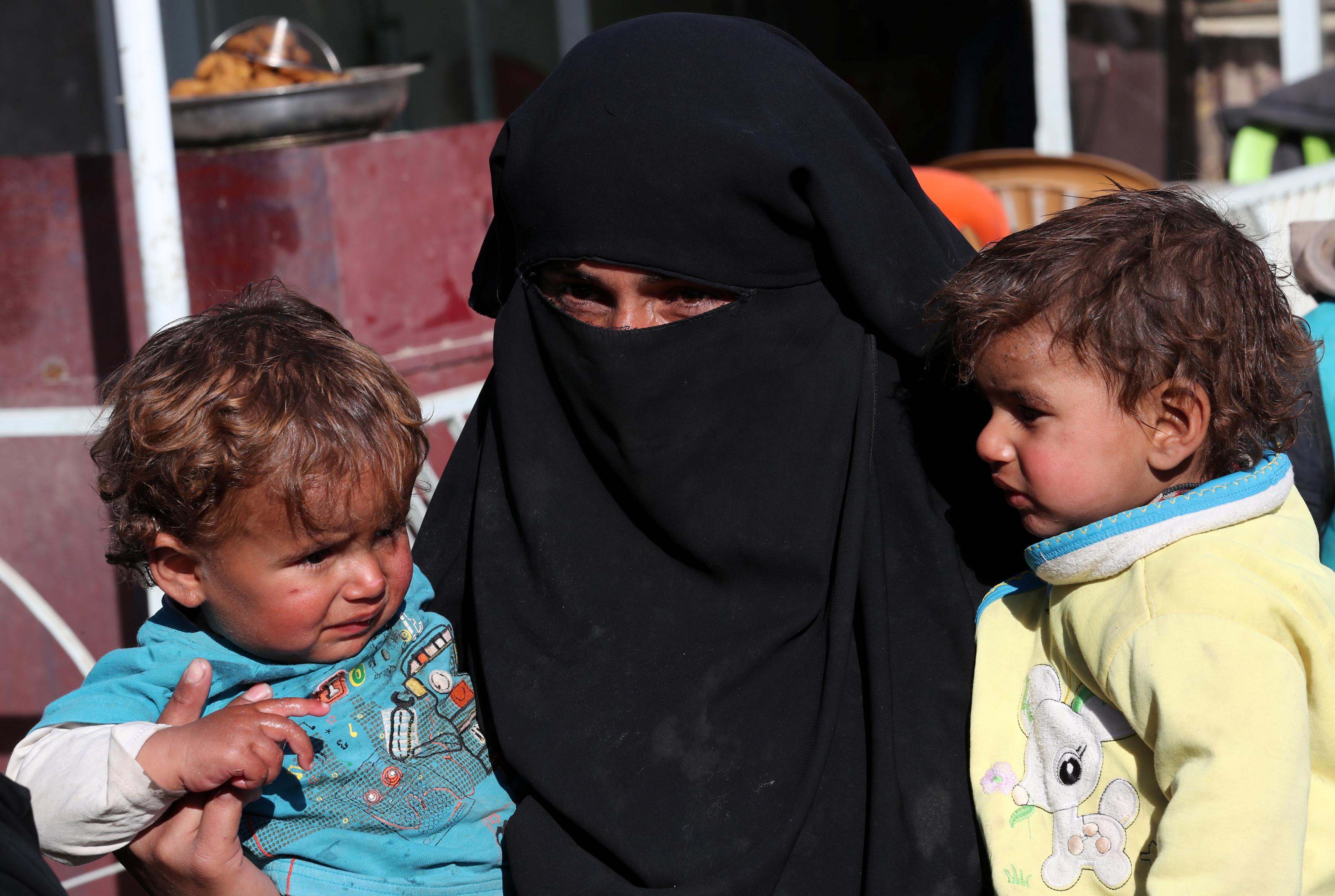 A woman and her children at a humanitarian aid distribution centre in Syria