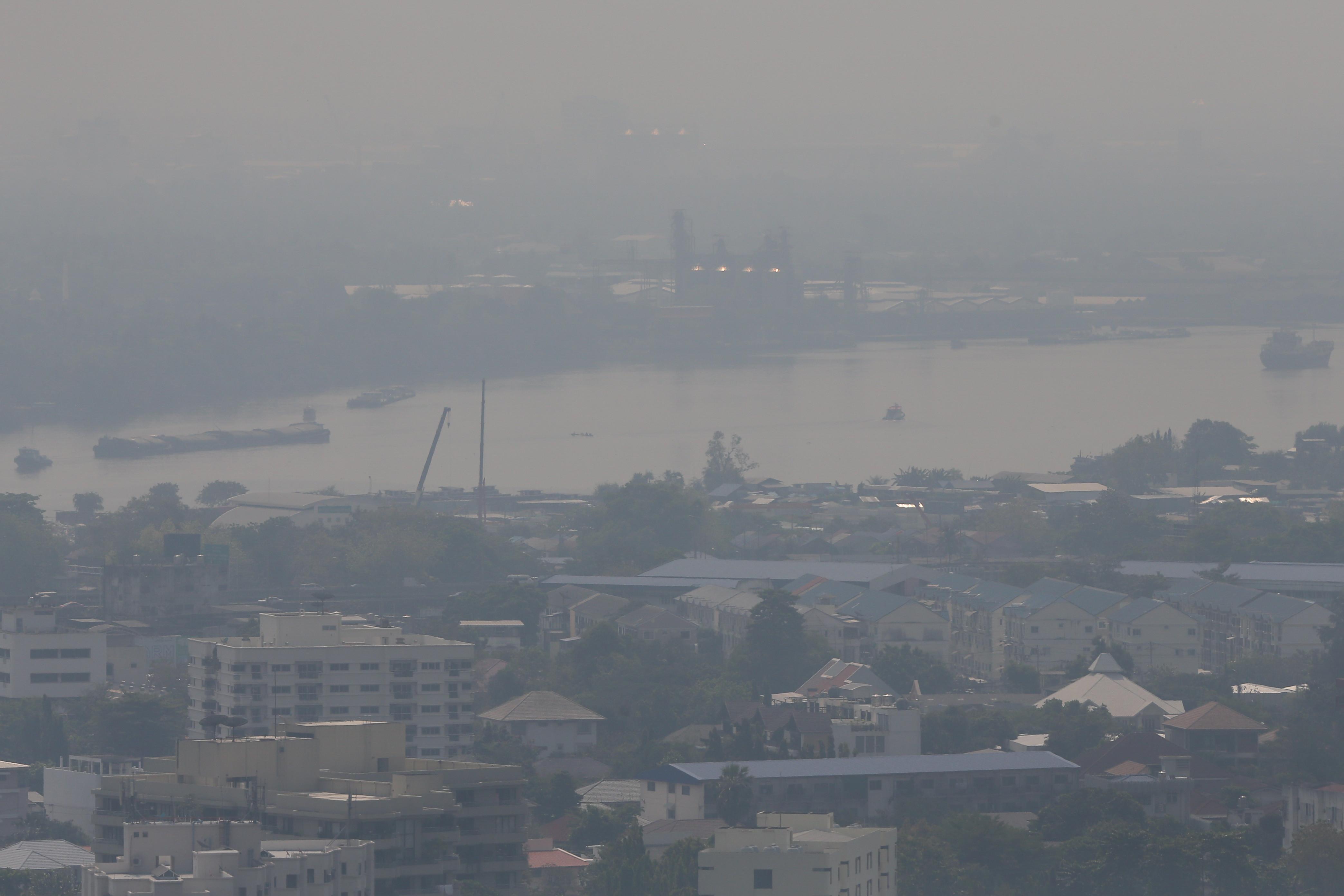 Smog over the Chao Phraya river in Bangkok, Thailand