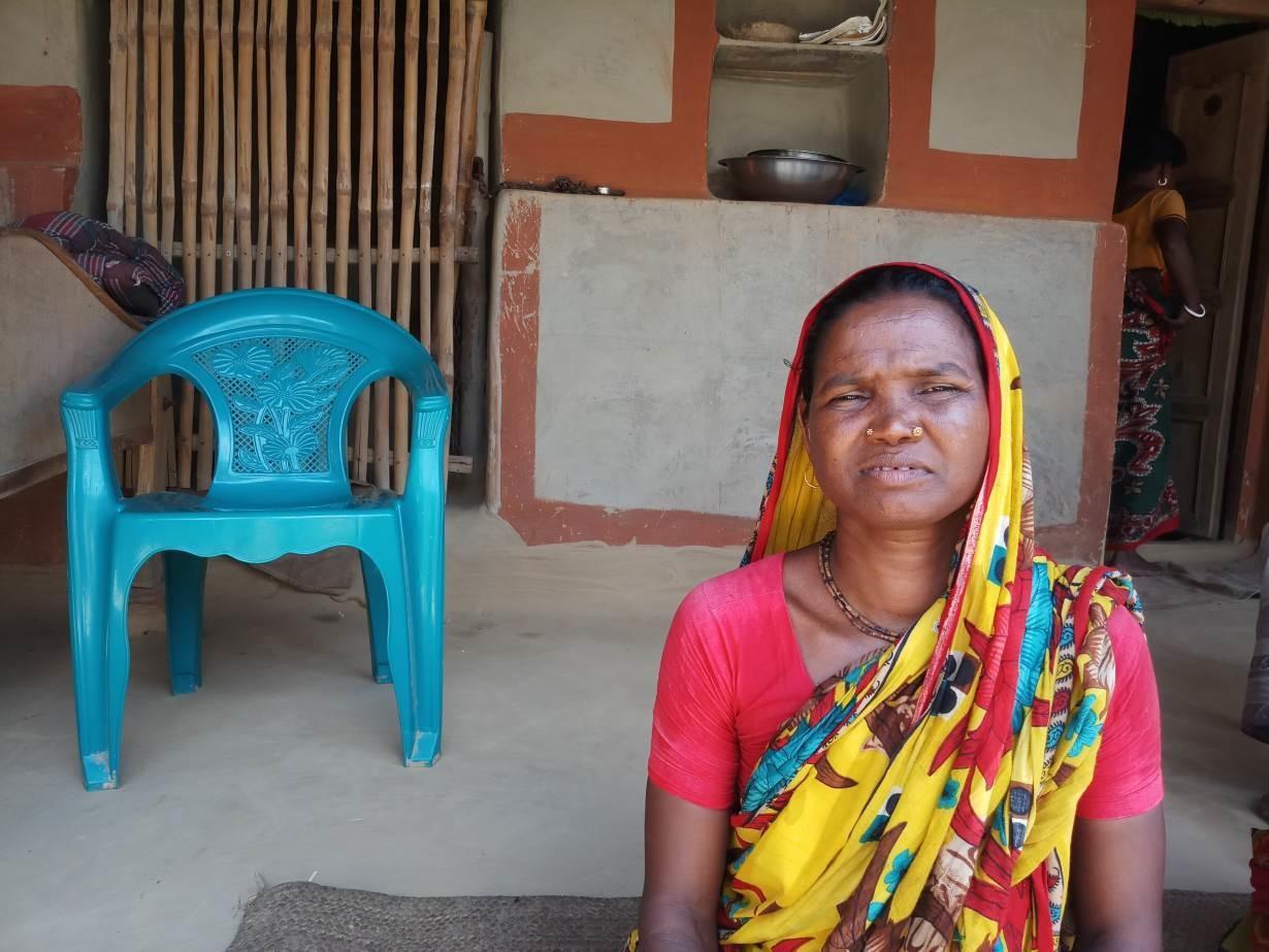 Oraon minority woman Kalamoti Kujur sits at home after losing her job as landowners turn rice fields into mango orchards in Naogaon district, Bangladesh, on September 21, 2019.
