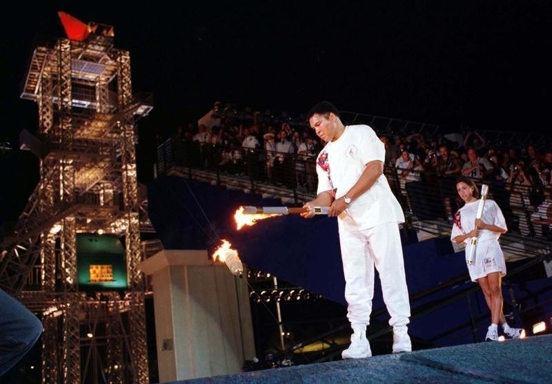 Former Olympic Boxer Muhammad Ali Lights The Device Which In Turn Will Light The Olympic Cauldron