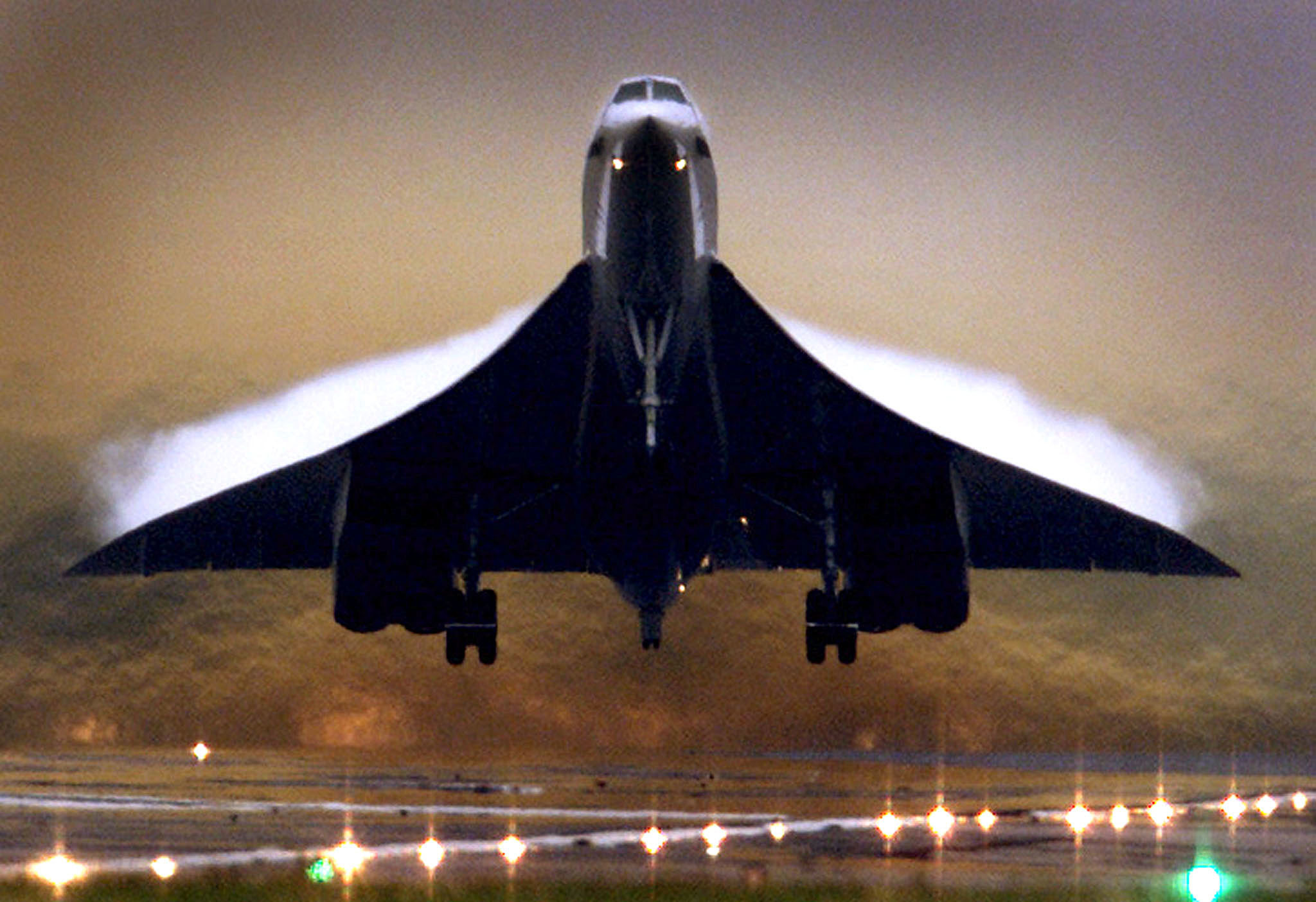 Vapour trails appear on the wings of a British Airways Concorde supersonic aircraft as it takes off from London's Heathrow airport July 24, 2000