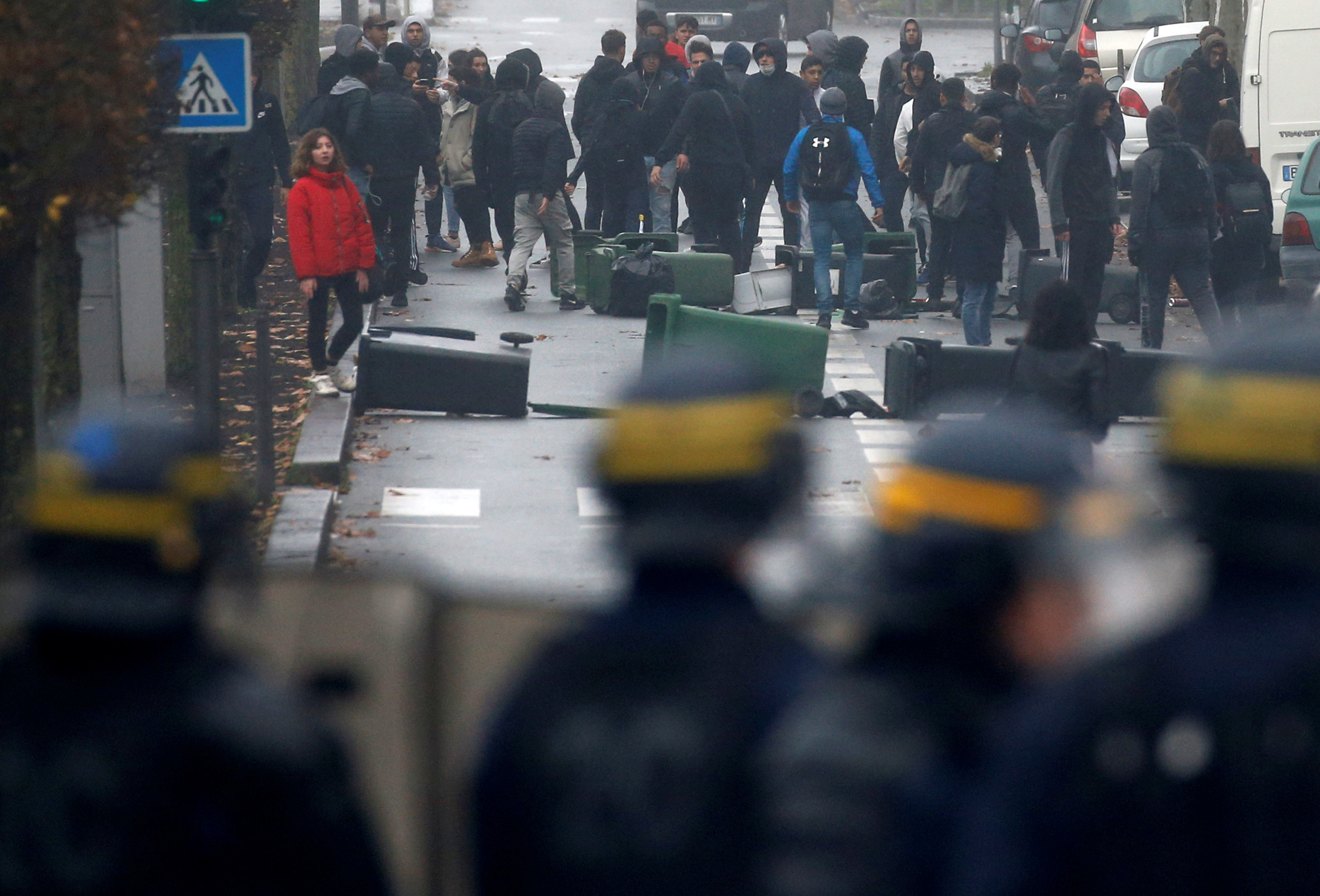 French riot police face off with youth and high school students during a protest against the French government's reform plan, in Bordeaux, France, December 6, 2018. REUTERS/Regis Duvignau - RC1C81AA5E00