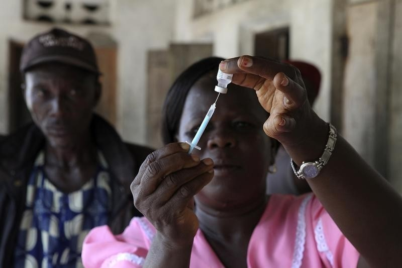 A health worker draws a dosage of vaccine into a syringe during a house call in the village of Kandor outside the town of Bo in the southeast region of the West African country May 24, 2011. Photo taken May 24, 2011.