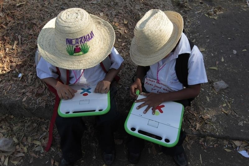 Schoolchildren use their XO laptops at the Municipal Stadium in Ciudad Sandino, on the outskirts of Managua, April 4, 2013. Around 3,000 schoolchildren will benefit from the delivery of the laptops, which were donated by the Zamora-Teran Foundation.