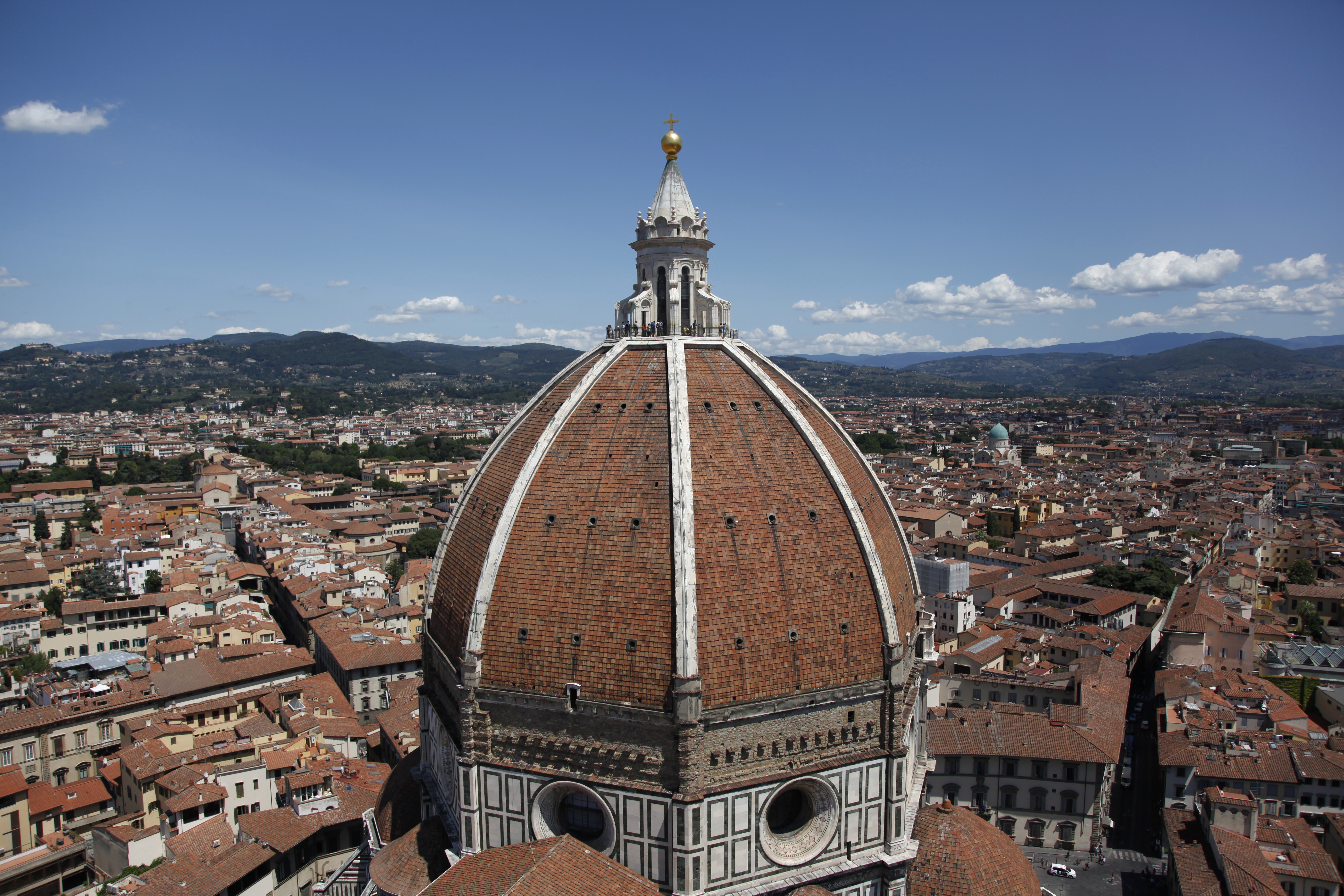 The dome of the Basilica di Santa Maria del Fiore is seen from Giotto's bell tower in Florence July 16, 2012. The cathedral complex, located in Pizza del Duomo, includes the bell tower and a Baptistery - all three buildings are part of the UNESCO World Heritage Site. REUTERS/Clarissa Cavalheiro (ITALY - Tags: TRAVEL RELIGION TPX IMAGES OF THE DAY) - GM1E8CE1S0N01