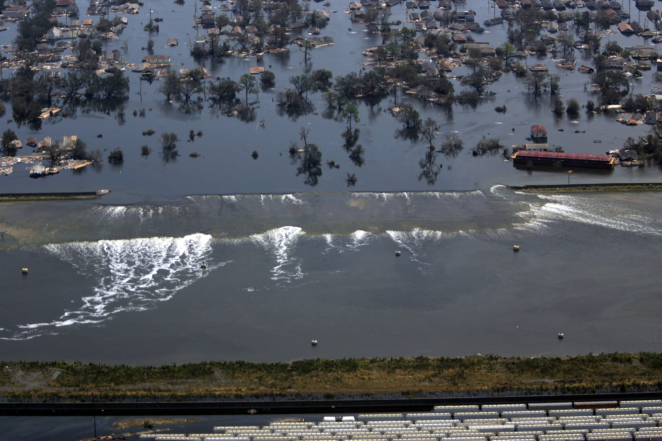 A levee gives way to high water in New Orleans, Louisiana, after hurricane Katrina struck on August 31, 2005. Hurricane Katrina strengthened into a rare top-ranked storm and barrelled into the vulnerable U.S. Gulf Coast for a second and more deadly assault on the Gulf Coast.