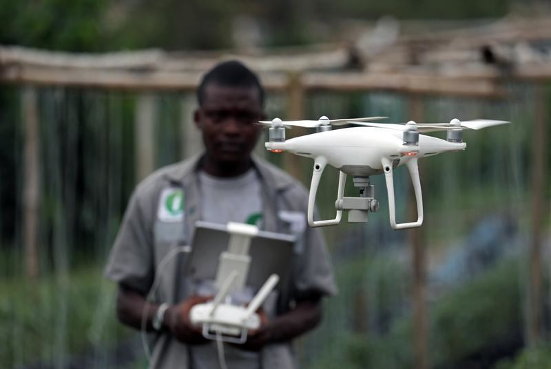 A member of the Ivorian Investiv Group startup, take off a drone at a tomatoes farm in northern Abidjan, Ivory Coast April 26, 2019. Picture taken April 26, 2019. REUTERS/Luc Gnago - RC1694DA1530
