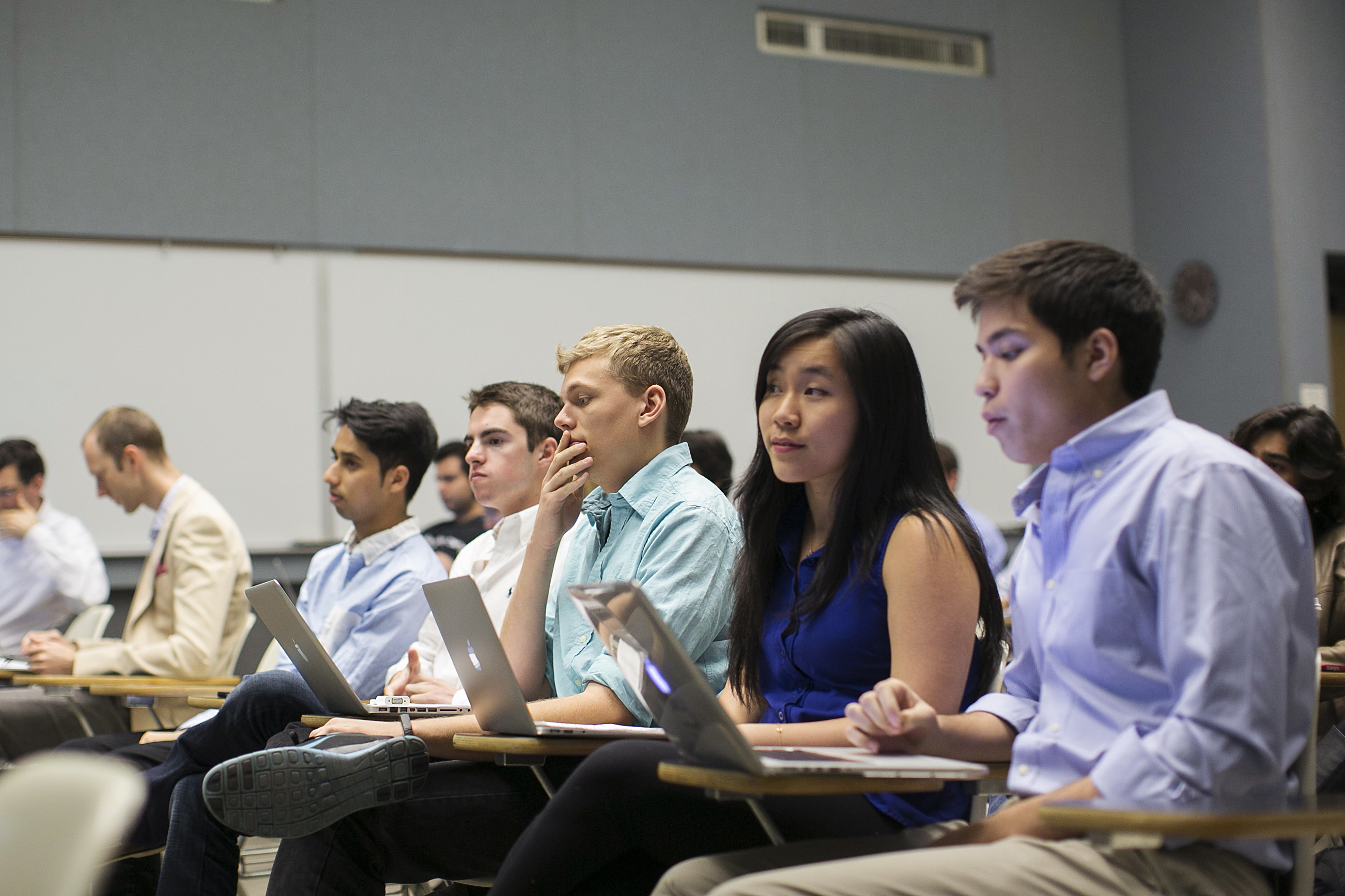 Stanford University students listen while classmates make a presentation to a group of visiting venture capitalists during their Technology Entrepreneurship class in Stanford, California March 11, 2014.