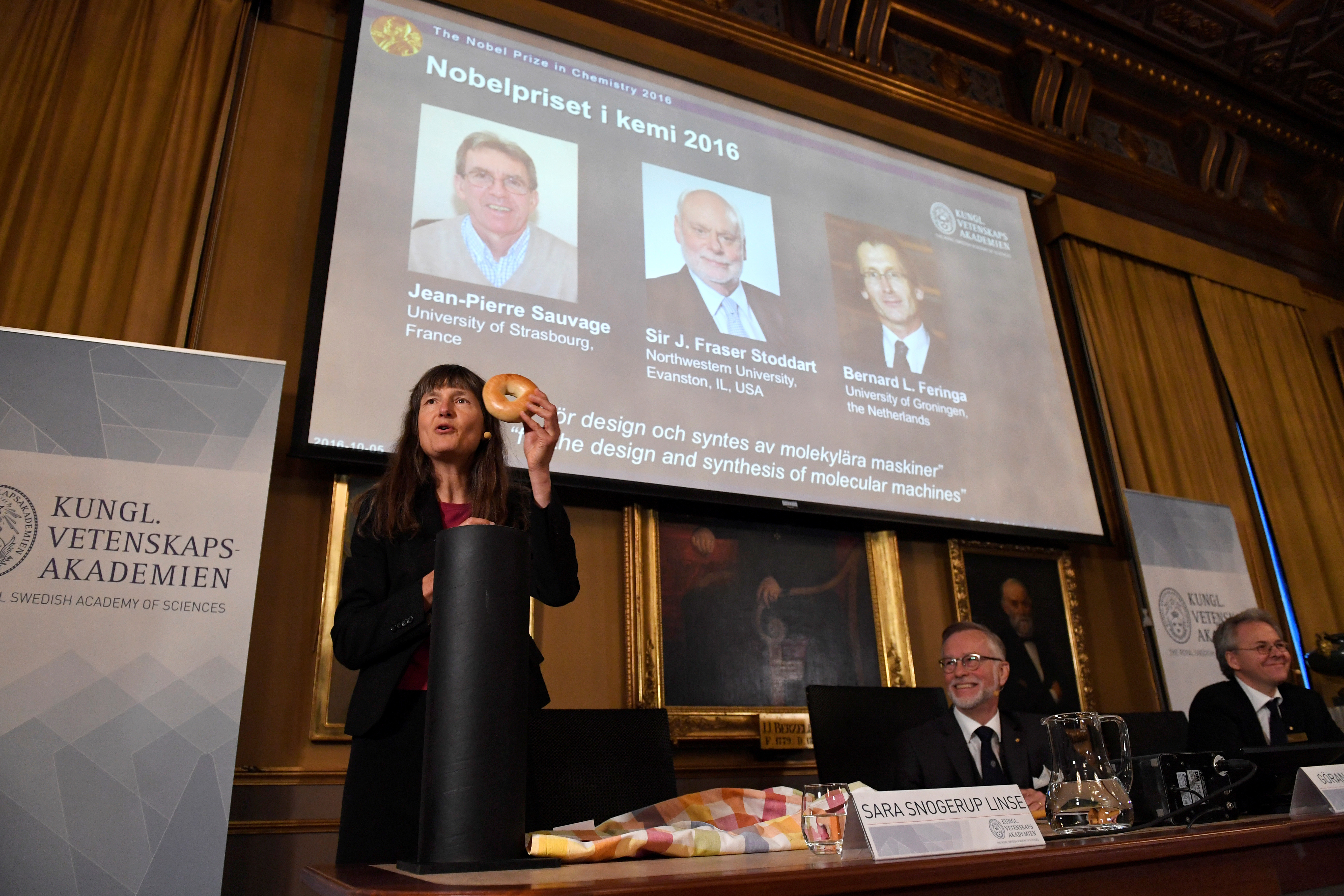 Pictures of the winners of the 2016 Nobel Chemistry Prize: Jean-Pierre Sauvage, J Fraser Stoddart and Bernard L Feringa are displayed on a screen during a news conference by the Royal Swedish Academy of Sciences in Stockholm, Sweden October 5, 2016. TT News Agency/Henrik Montgomery/via Reuters?ATTENTION EDITORS - THIS IMAGE WAS PROVIDED BY A THIRD PARTY. FOR EDITORIAL USE ONLY. NOT FOR SALE FOR MARKETING OR ADVERTISING CAMPAIGNS. SWEDEN OUT. NO COMMERCIAL OR EDITORIAL SALES IN SWEDEN. NO COMMERCIAL SALES. - RTSQUAN