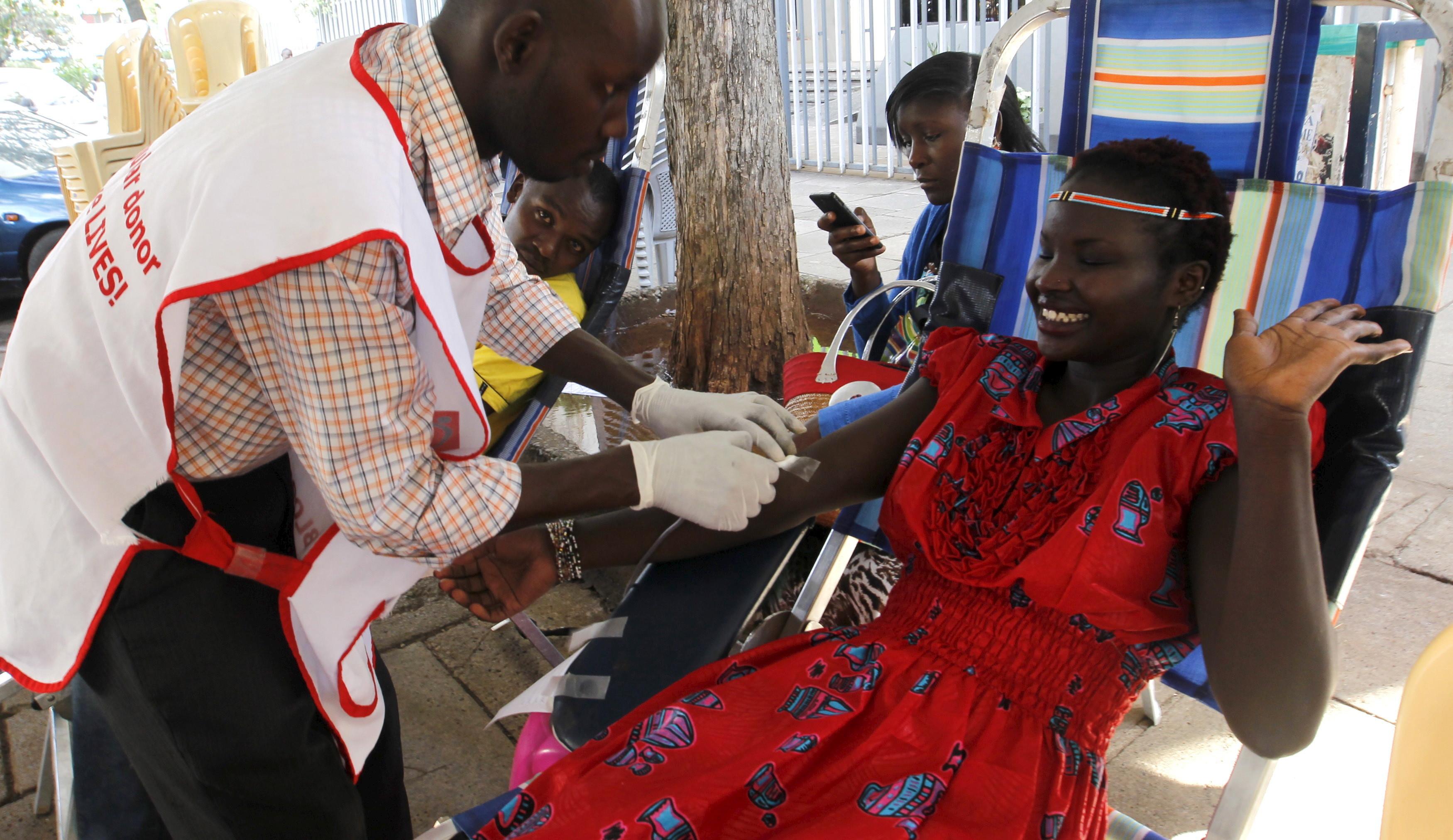 A woman donates blood in Kenya.