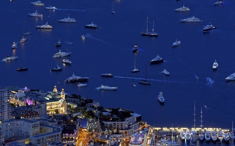 A general view shows Monte Carlo Casino and Opera (L) as the MonacoYacht show, one of the most prestigious pleasure boat show in the world, highlighting hundreds of yachts for the luxury yachting industry runs in Monte Carlo port September 25, 2015. REUTERS/Eric Gaillard    - GF10000221019