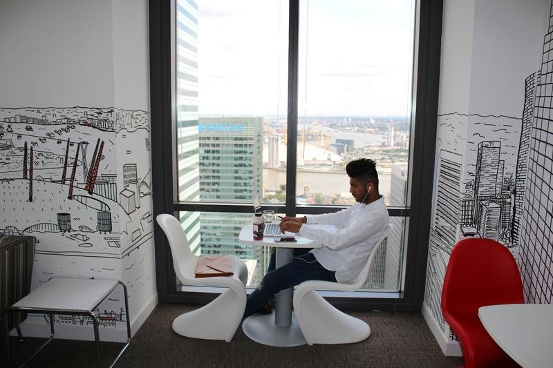 A man uses a laptop in the Level39 FinTech hub based in the One Canada Square tower of the Canary Wharf district of London, Britain, August 5, 2016.