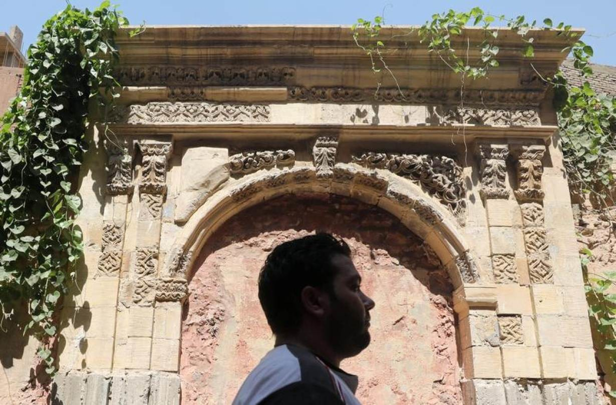 A man walks past an old arch that was restored and fitted inside a historic house in Darb al-Ahmar neighbourhood in Cairo, Egypt August 31, 2019. Picture taken August 31, 2019.