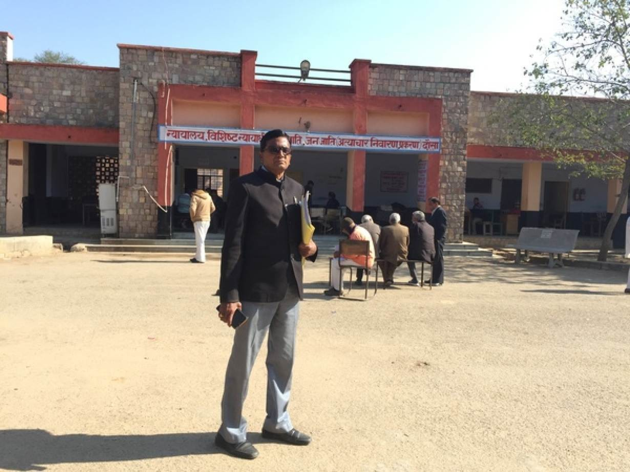 Advocate Durga Prasad Saini who had collected data on mass hysterectomies in private hospitals in Rajasthan poses for a picture outside a local court in Dausa, India, January 29, 2019.