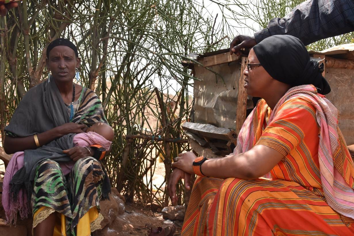 Fatima, who overcame pregnancy complications, chats to community health worker Dahabo Adi Galgallo in Moyale, Kenya, April 9, 2019.