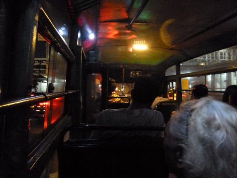 The atmosphere of the Metro Mini bus at night.
