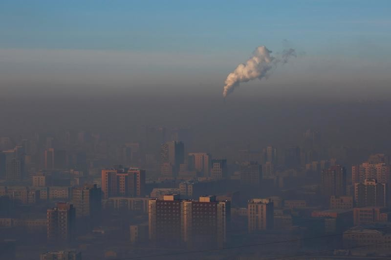 Emissions from a power plant chimney rise over Ulaanbaatar, Mongolia January 13, 2017.  REUTERS/B. Rentsendorj   SEARCH