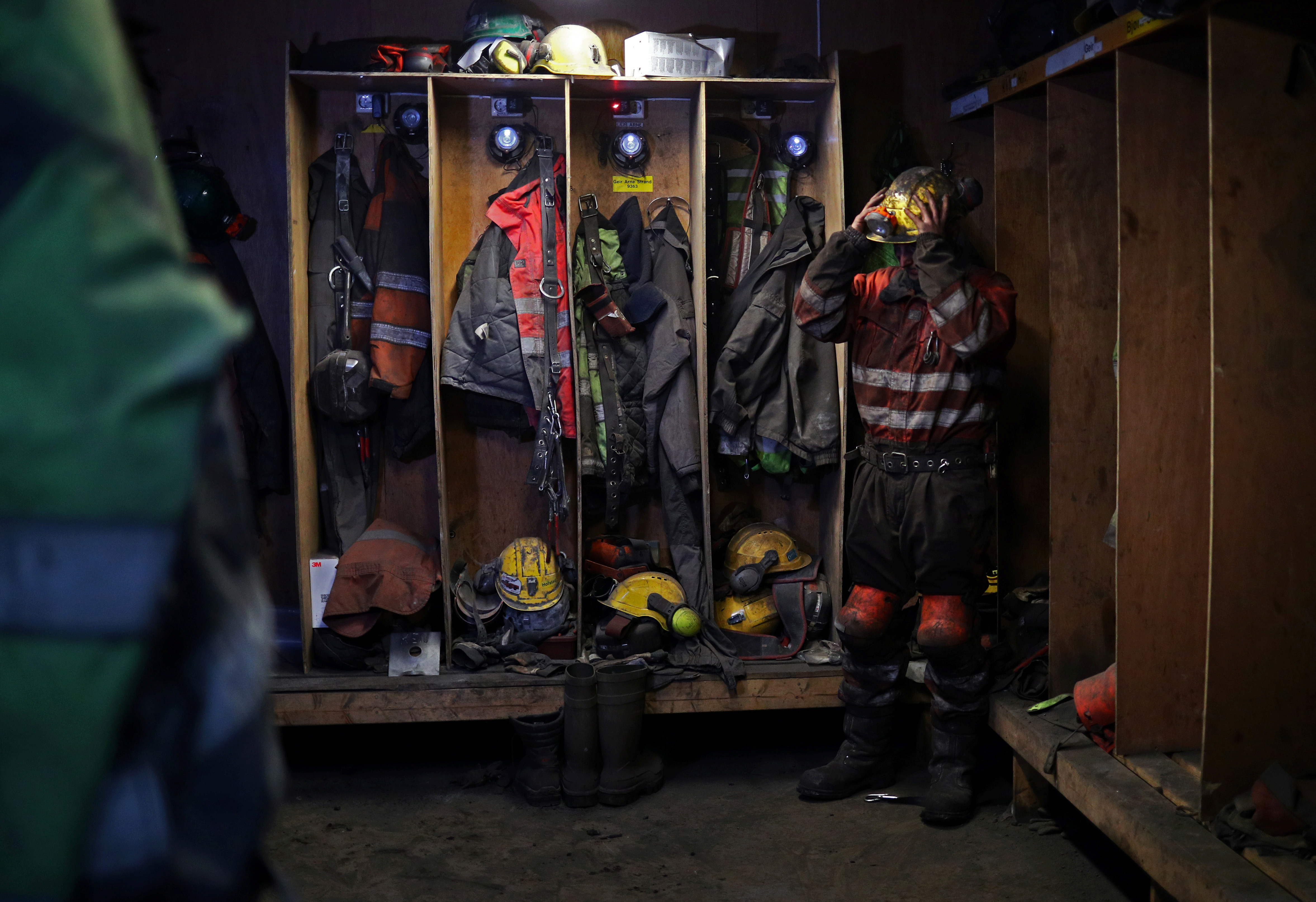 Miner Odd Rune Svenning, 26, changes his clothes after working inside the Gruve 7 mine, the only remaining operational coal mine on Svalbard, Norway, August 7, 2019. Svenning has worked in the mine for two years.