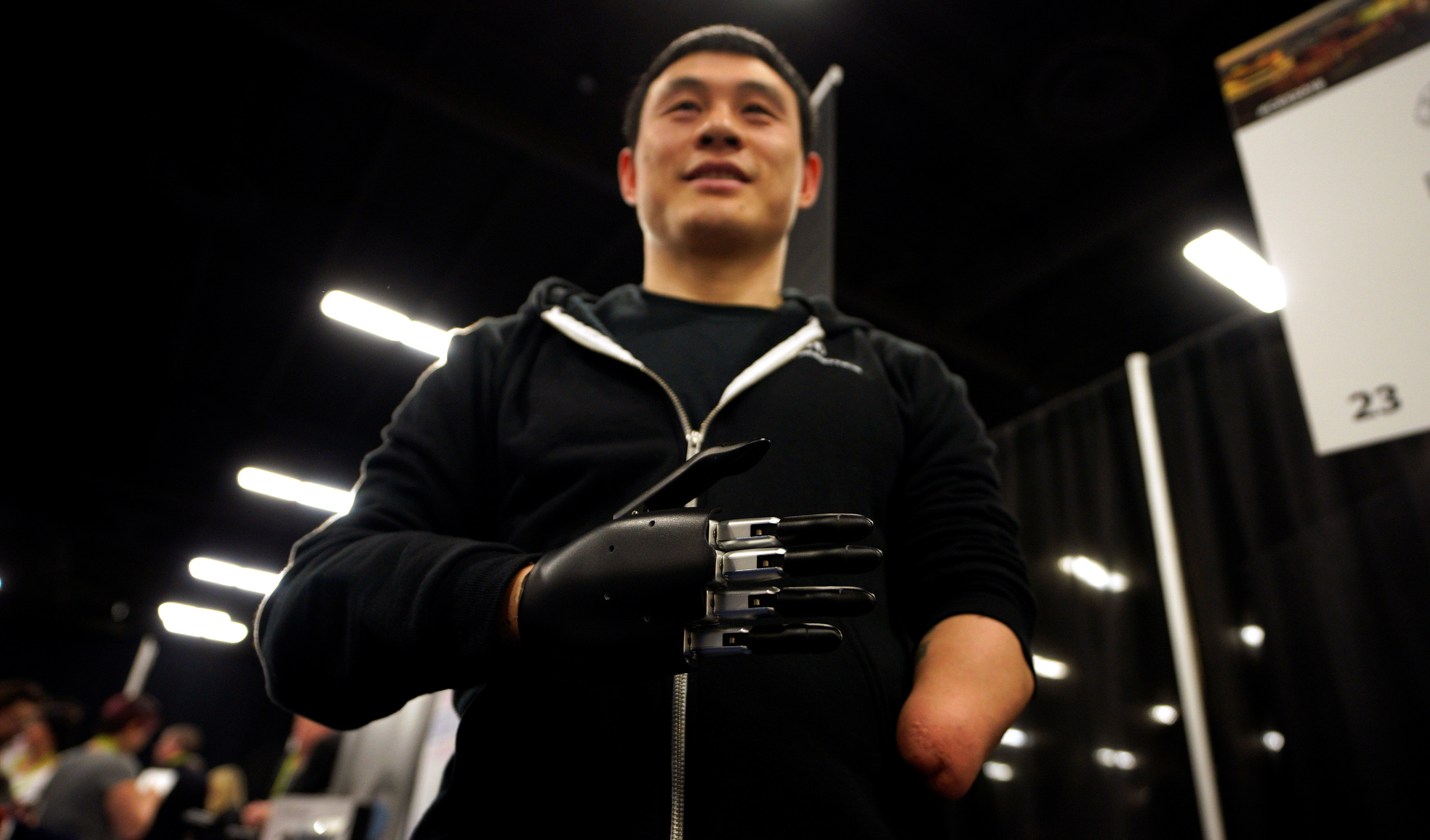 A user demonstrates an Brain Robotics AI-powered prosthetic hand.