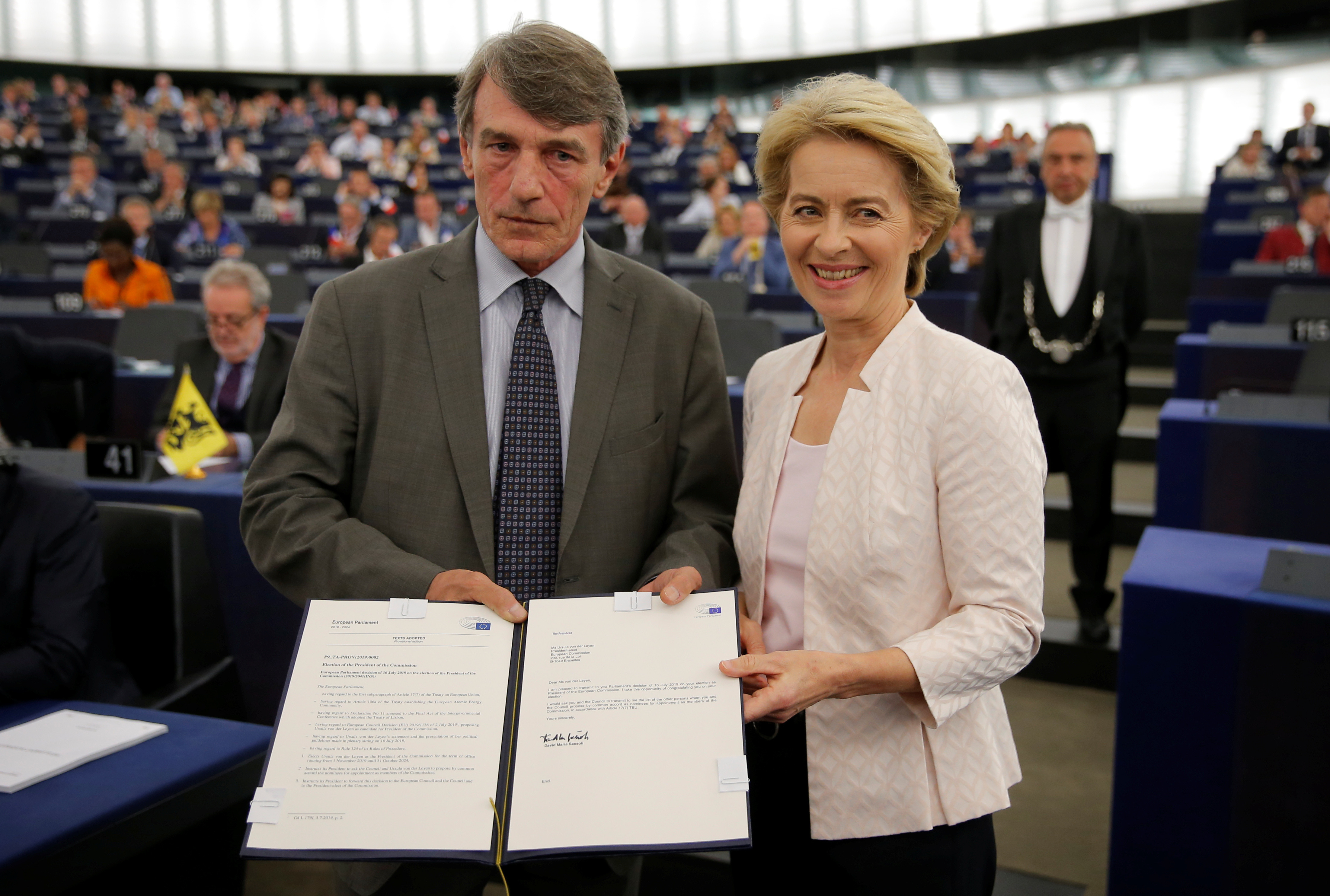 Ursula von der Leyen is congratulated by European Parliament President David-Maria Sassoli after her election as European Commission president