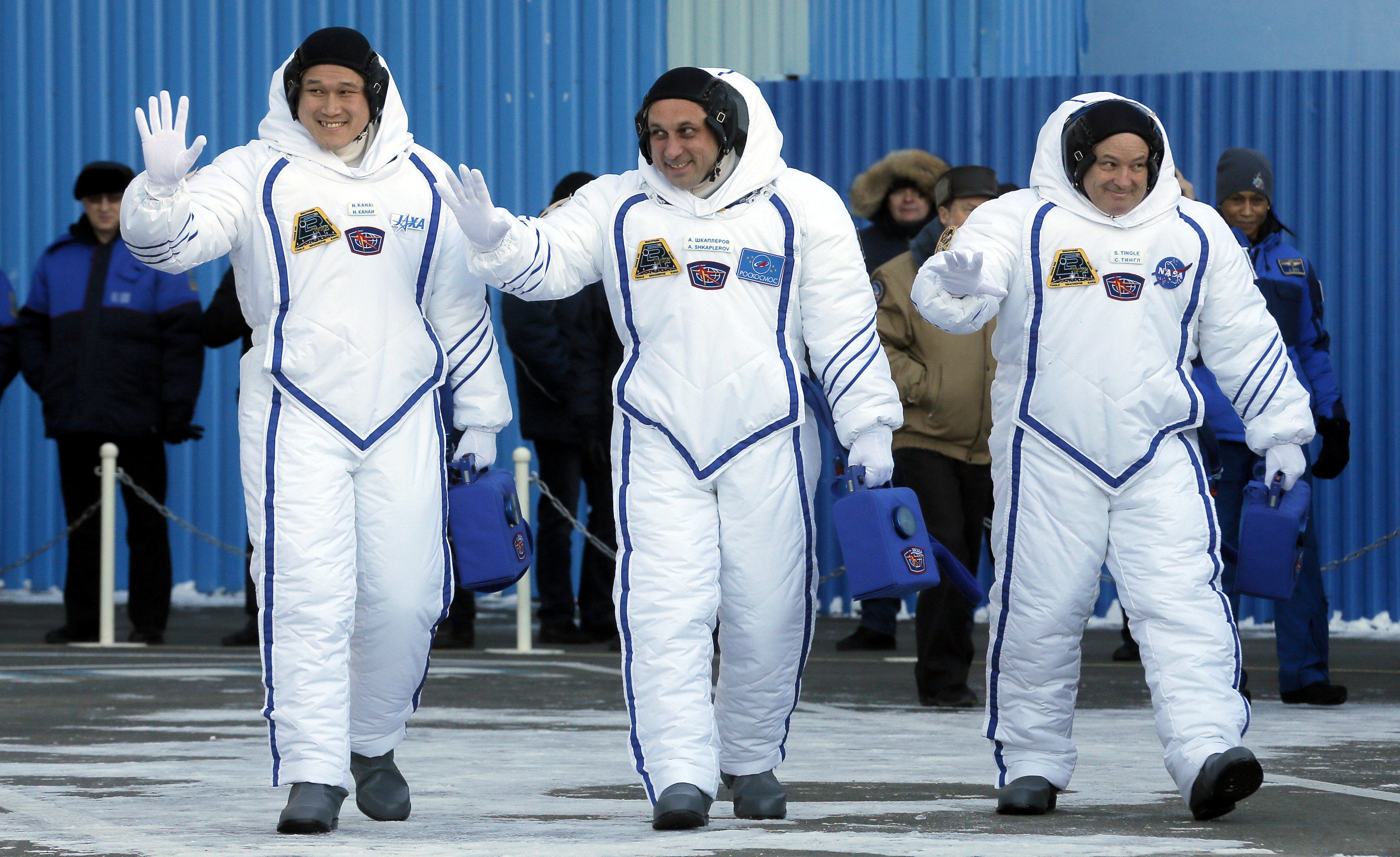 Norishige Kanai of the Japan Aerospace Exploration Agency, Roscosmos cosmonaut Anton Shkaplerov and NASA astronaut Scott Tingle during a send-off ceremony to the ISS in December.